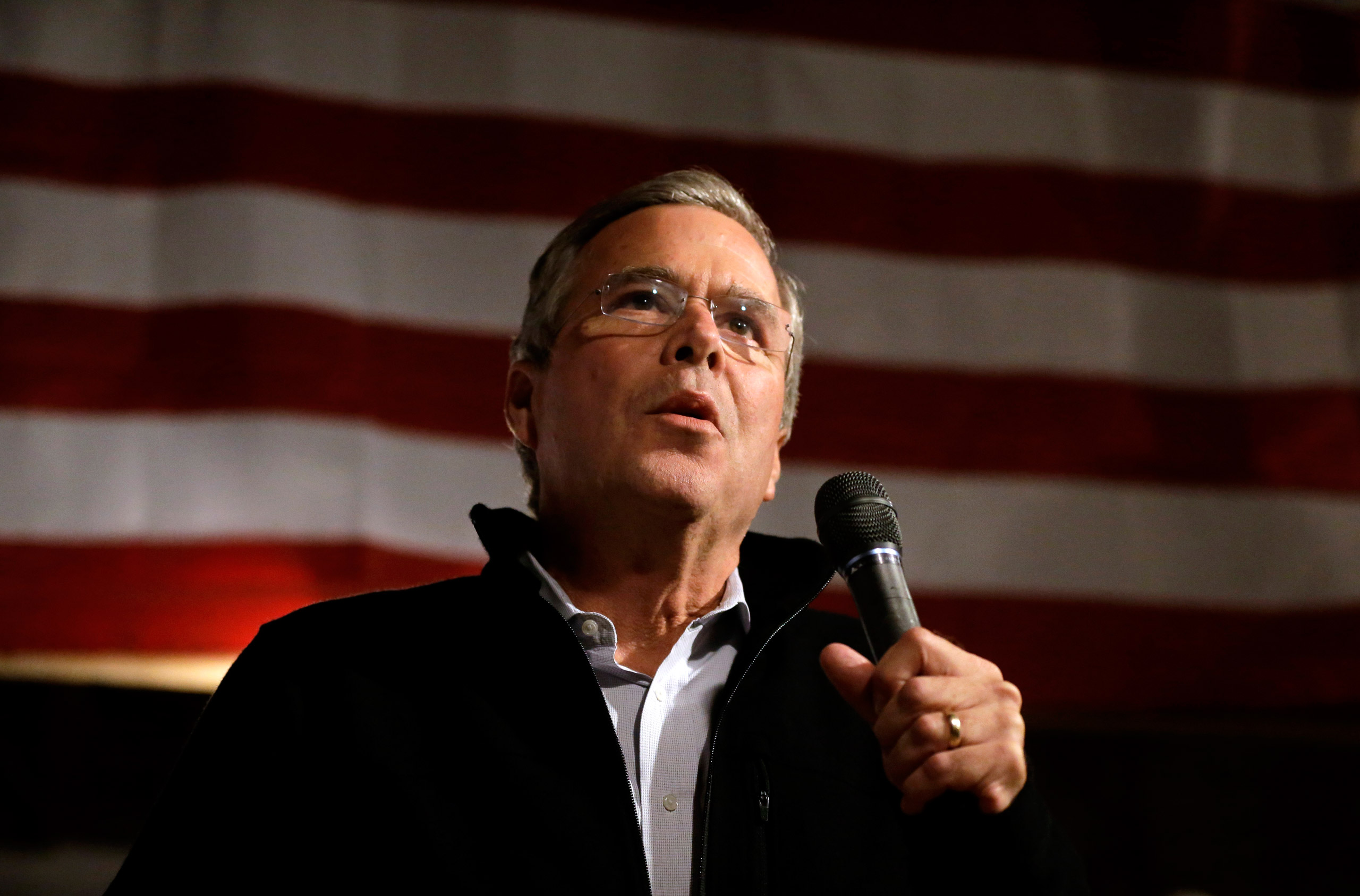 Jeb Bush addresses an audience at a campaign event held in a barn belonging to former Sen. Scott Brown in Rye, N.H., on Nov. 3, 2015.