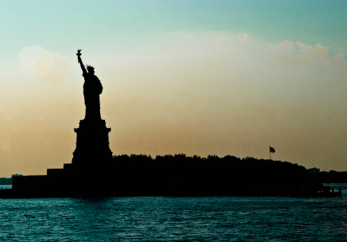 Statue of Liberty silhouetted at dawn