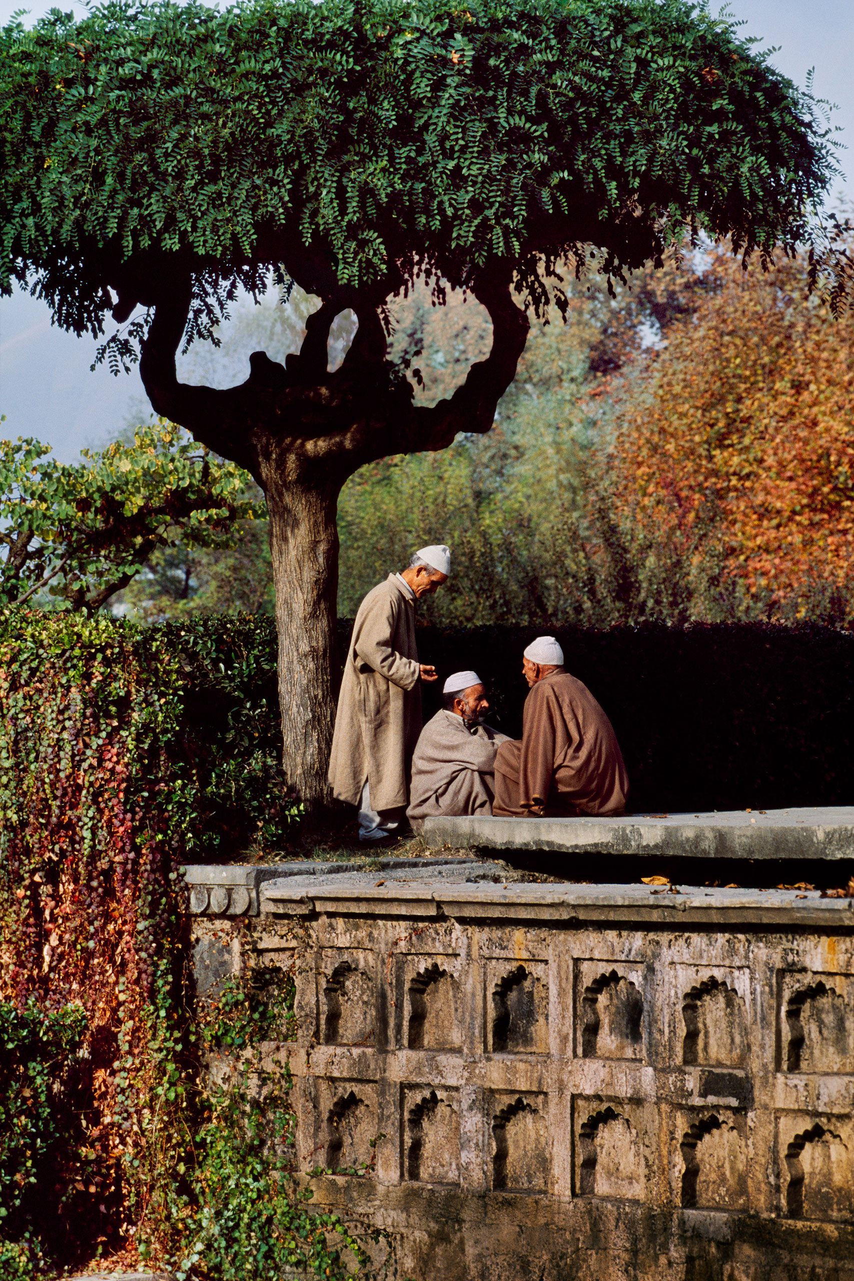 Three friends in Shalimar Gardens. Srinagar, Kashmir, 1998