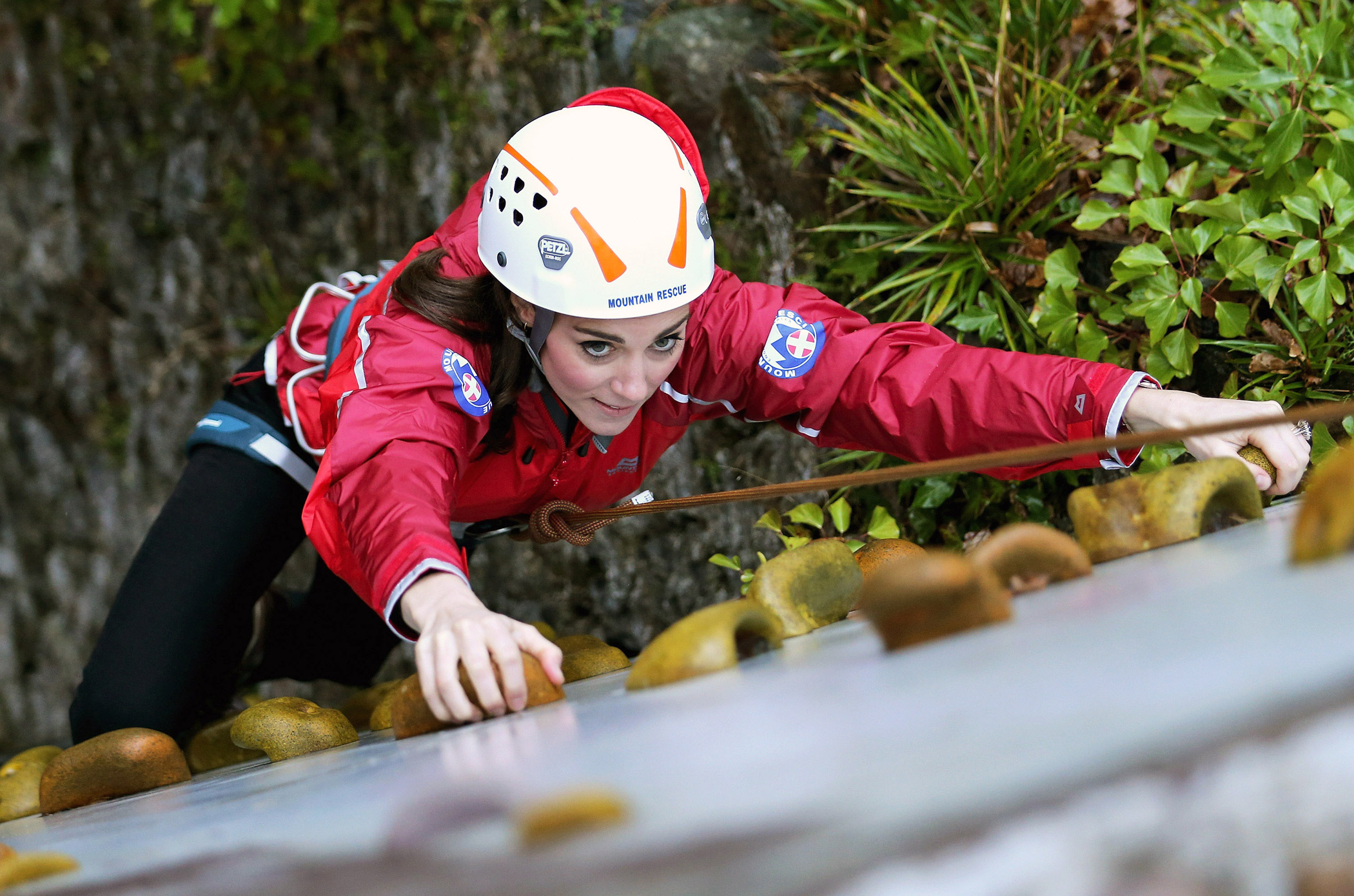 Princess Kate, Duchess of Cambridge, ascends a climbing wall at the Towers Residential Outdoor Education Centre.