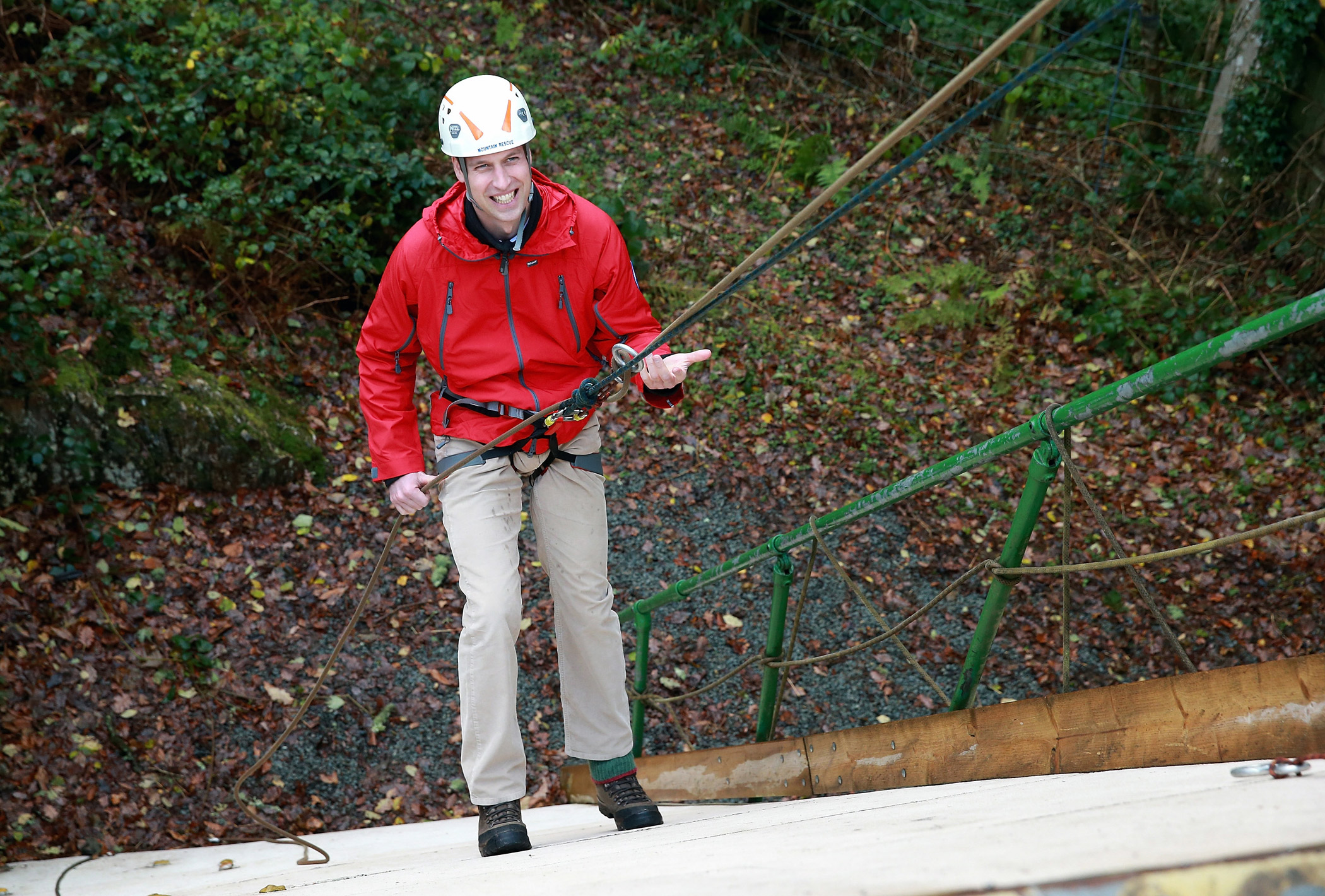 Prince William, Duke of Cambridge, abseils  down a wall at  the Towers Residential Outdoor Education Centre.