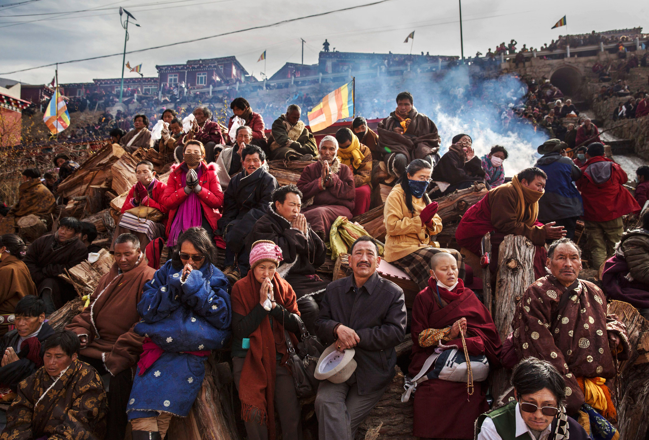 Tibetan Buddhists pray on a hillside at the Larung Wuming Buddhist Institute, which is popular for followers from all over the Tibetan areas and other parts of China.