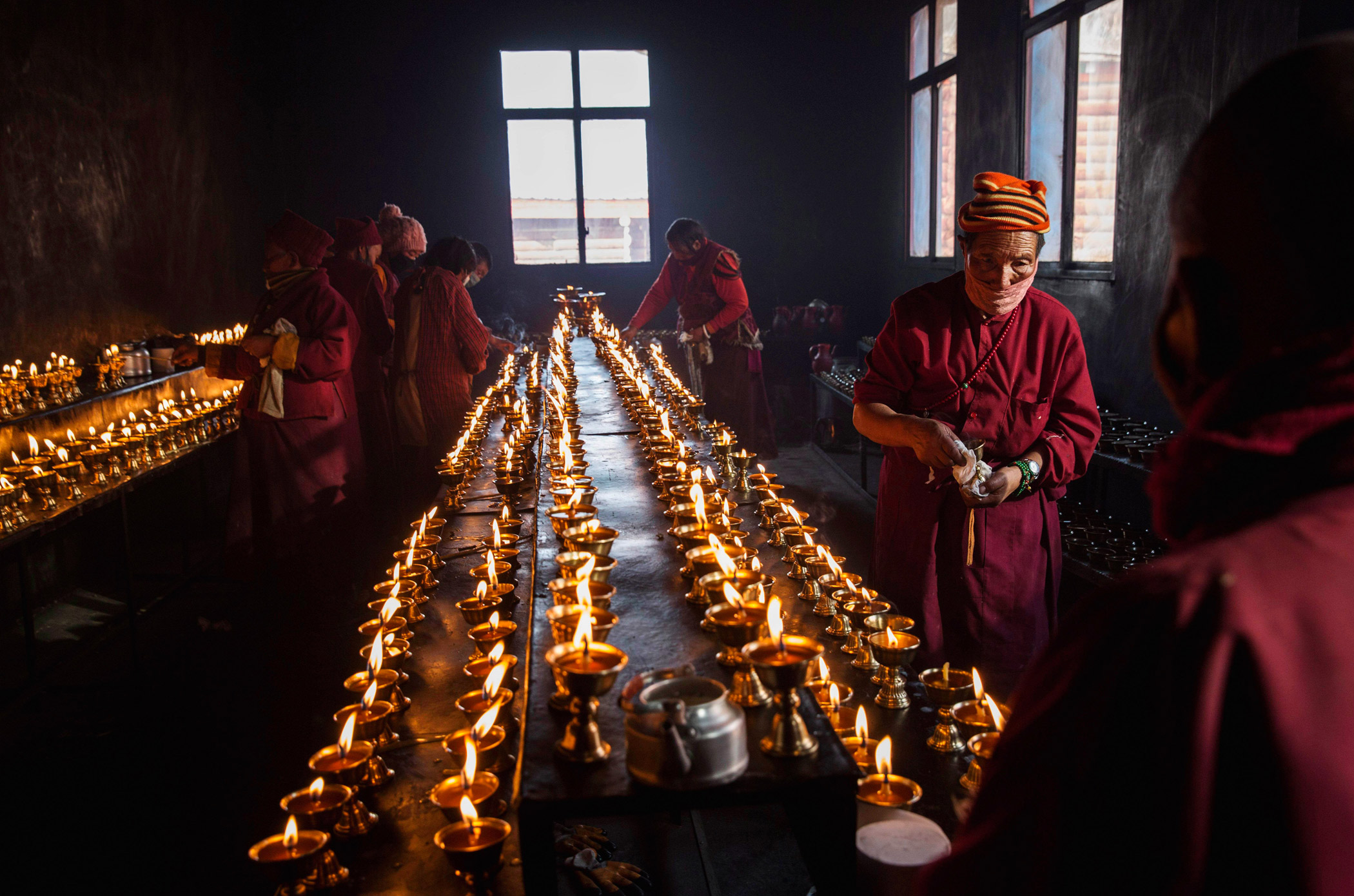 Butter lamps are prepared during the annual Bliss Dharma Assembly at the Larung Wuming Buddhist Institute on Oct. 31.