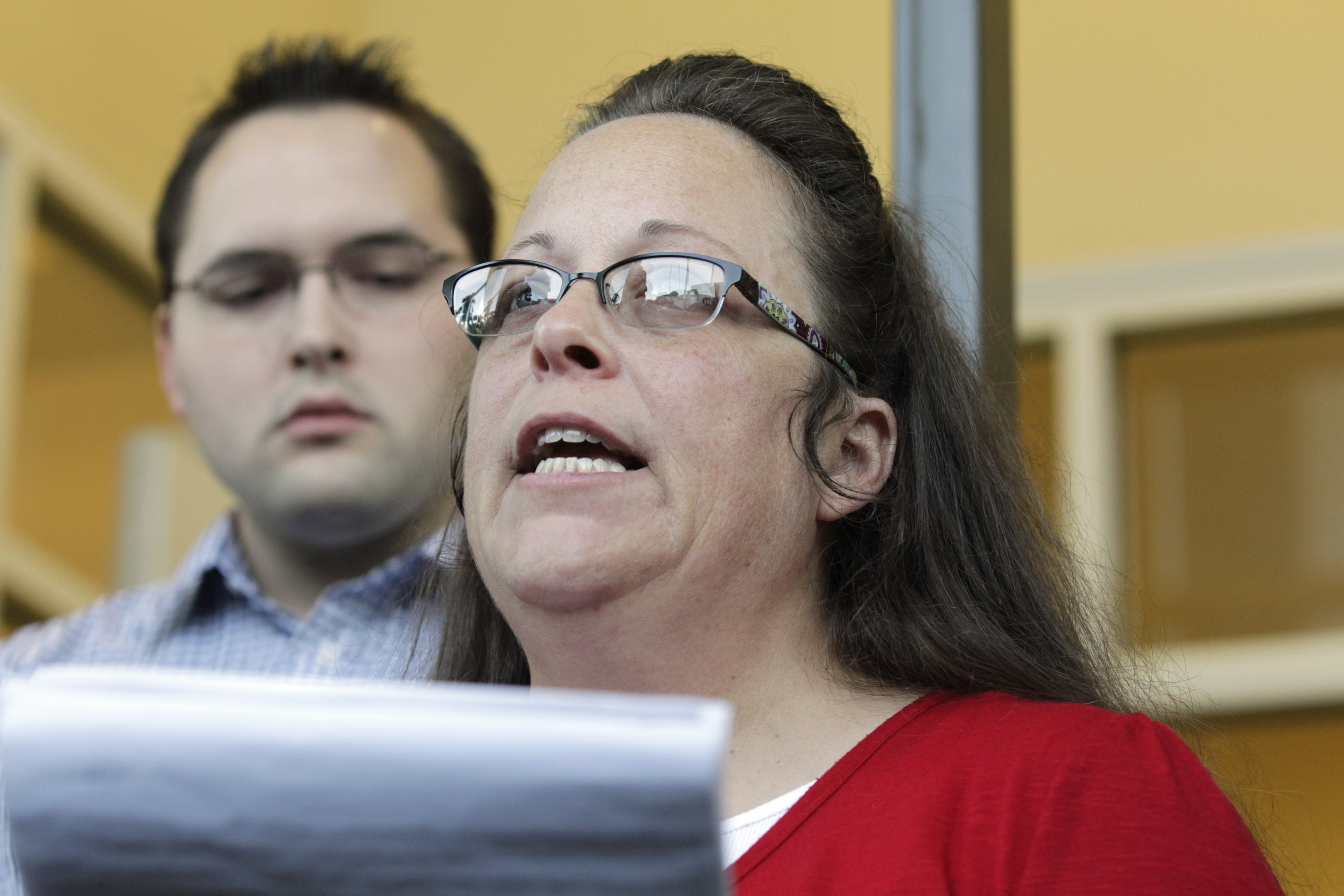 Rowan County Clerk Kim Davis, with son Nathan Davis, a deputy clerk, reads a statement to the press outside the Rowan County Courthouse on Sept. 14, 2015 in Morehead, Ky. (Pablo Alcala/Lexington Herald--Leader/TNSGetty Images)