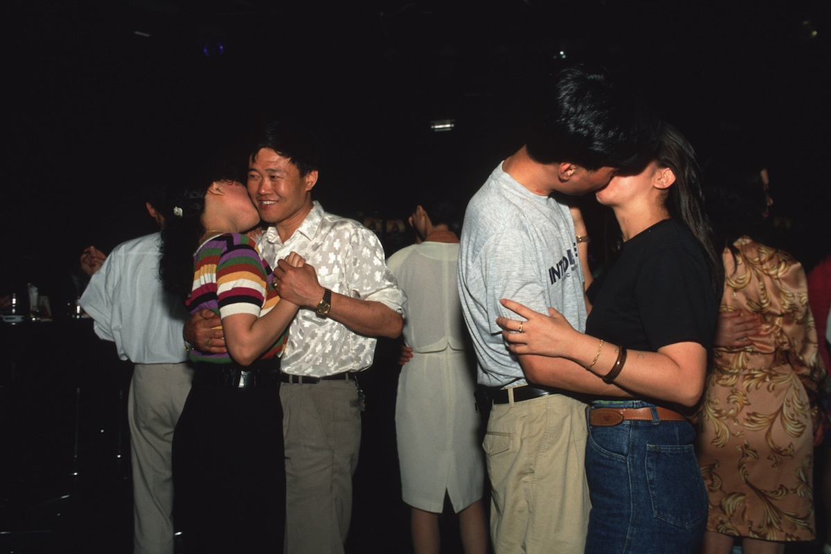Couples slow dancing at a disco next to Jinjiang Hotel in downtown Shanghai on Jan. 12, 1992