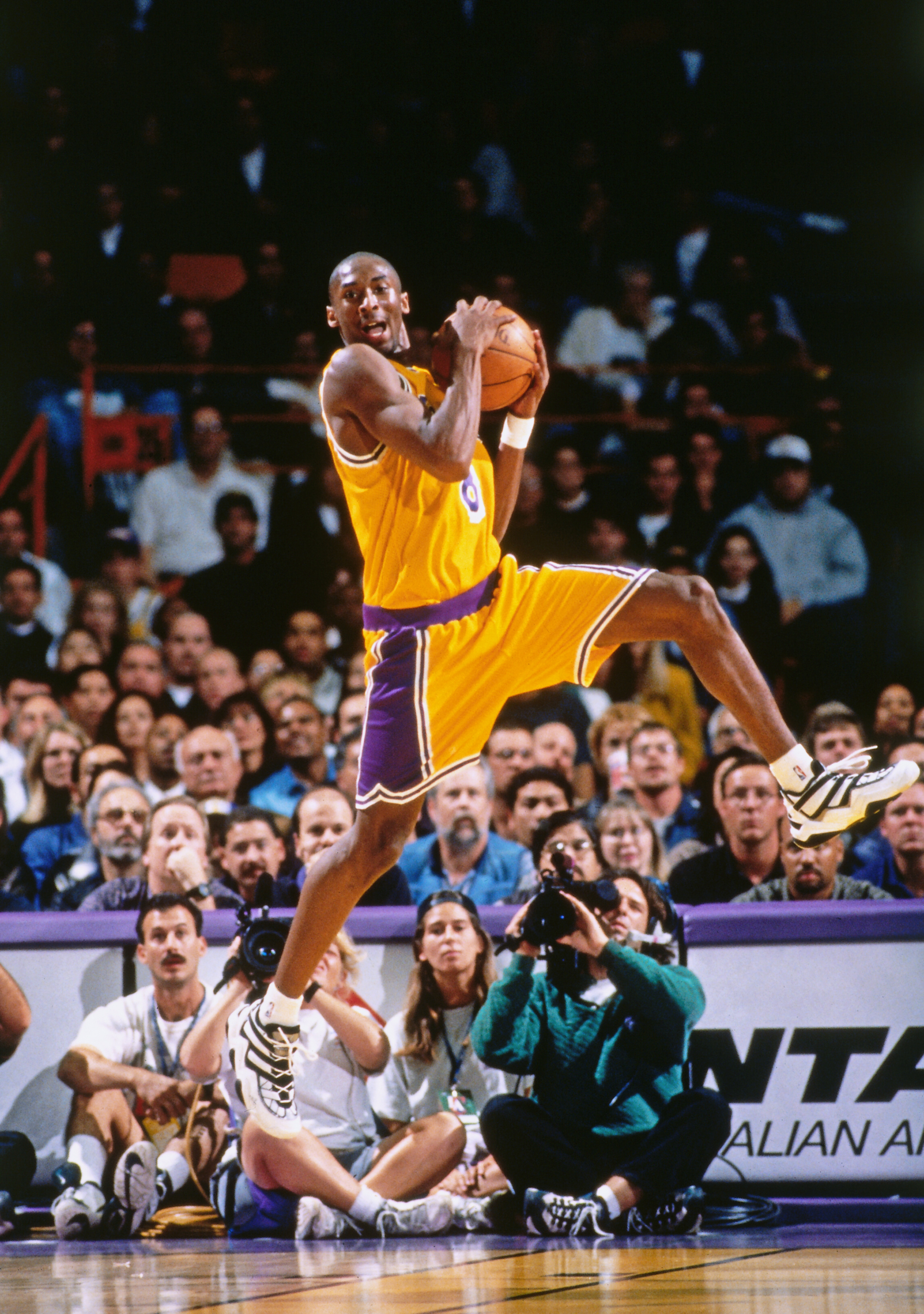 Bryant rebounds against the Minnesota Timberwolves in his first regular season game at The Forum in Inglewood, Calif., on Nov. 3, 1996. At the time, he became the youngest-ever player to play in an NBA game.