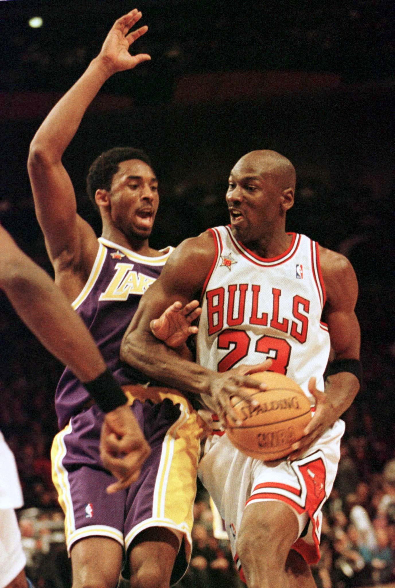 Bryant's real emergence as a budding star came in his second season, when he became the youngest starter in an NBA All-Star Game in New York's Madison Square Garden on Feb 8., 1998. He had already begun to elicit comparisons to Chicago Bulls star Michael Jordan, seen here driving past him.
