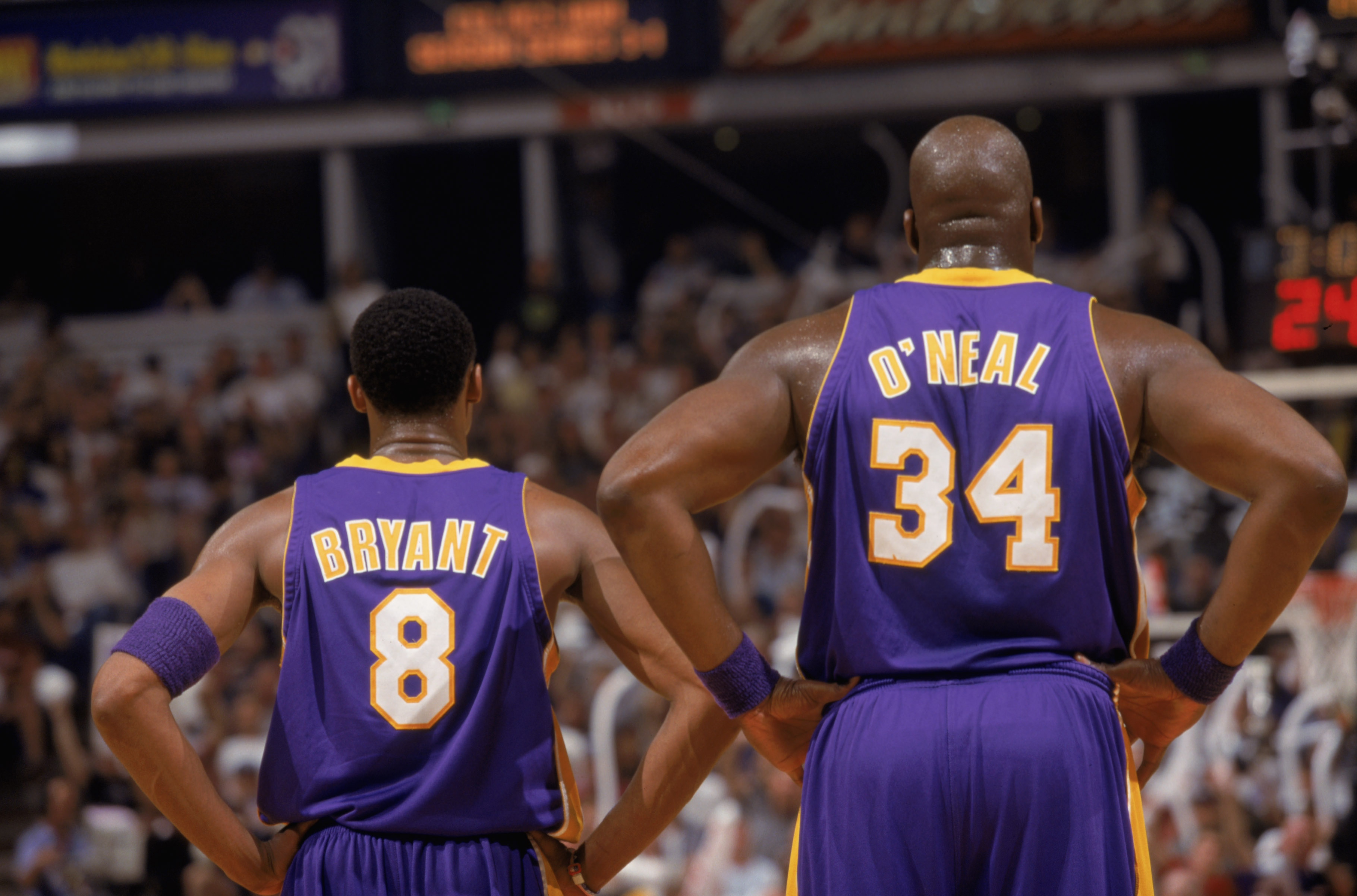 Bryant stands next to his teammate Shaquille O'Neal during game 1 of the Western Conference Finals during the 2002 NBA Playoffs against the Sacramento Kings at the Arco Arena in Sacramento on May 18, 2002. The duo would be continue their dominance of the NBA, with the 2002 Championship being the last they'd win together. O'Neal was traded to the Miami Heat in 2004, while Bryant signed a new seven-year contract with the Lakers.