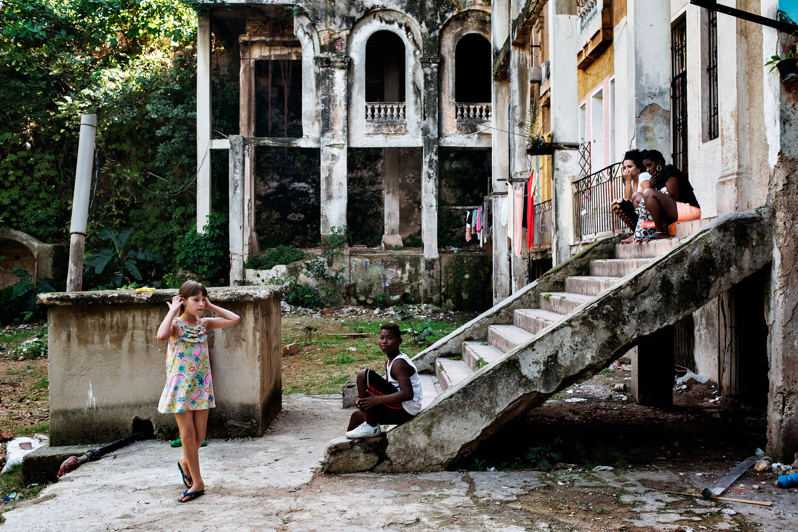 Young girls play on the grounds of the Arcos building, an iconic building in the El Vedado neighborhood of Havana.From  Take a Walk Through the Streets of Cuba
