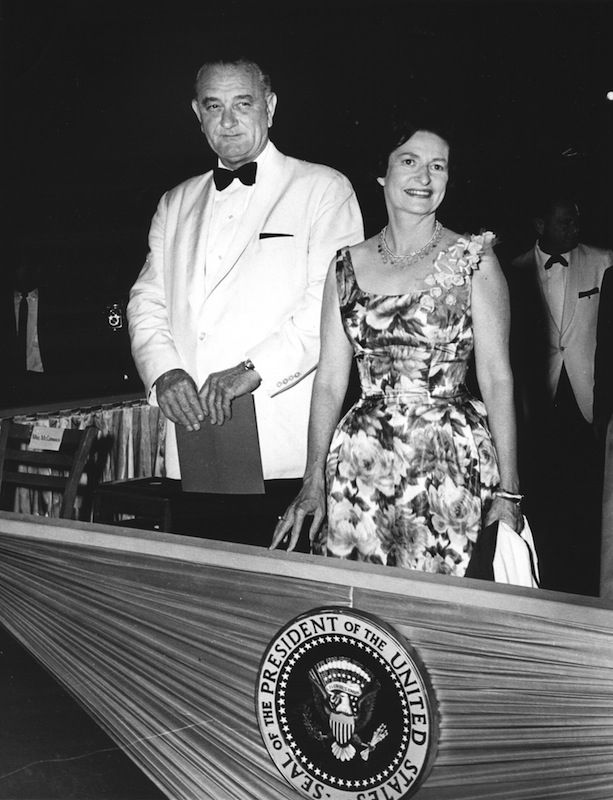 US President Lyndon Johnson and his wife, First Lady Lady Bird Johnson attend an  event in Washington DC, May 26, 1964.