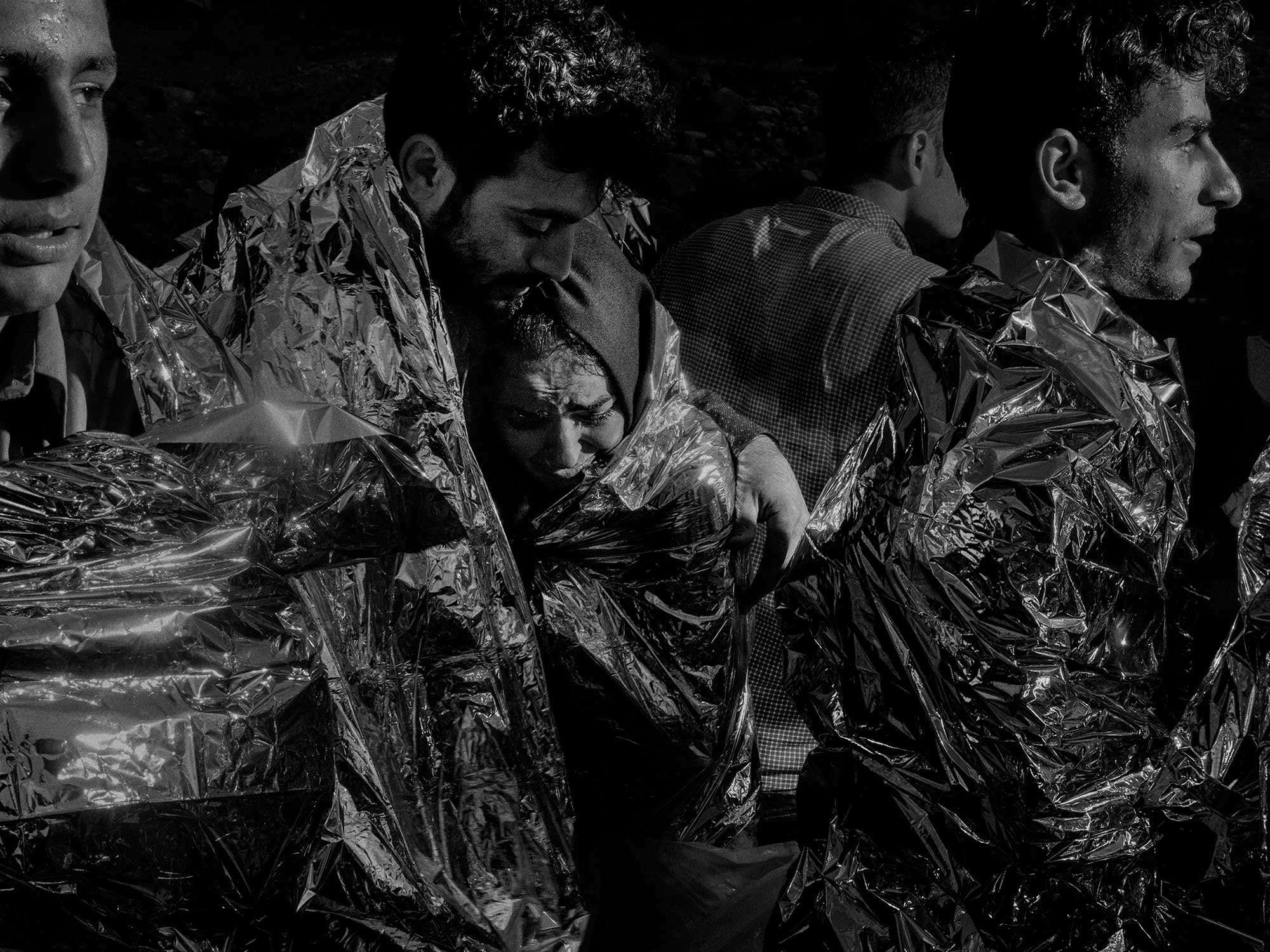 The New Yorker Photo Booth: A Tragedy Unfolds on LesvosRefugees and migrants from Syria, Afghanistan, Pakistan, and Somalia arrive on the northern shores of Lesvos after their journey from the Turkish coast. Lesvos, Greece, 2015.