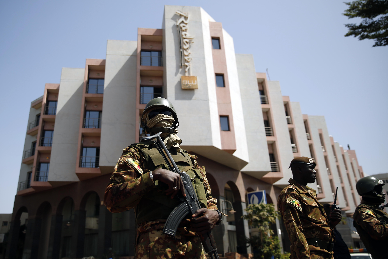 Tight security surrounds Malian  President Ibrahim Boubacar Keita as he visits the Radisson Blu hotel in Bamako, Mali on Nov. 21, 2015.