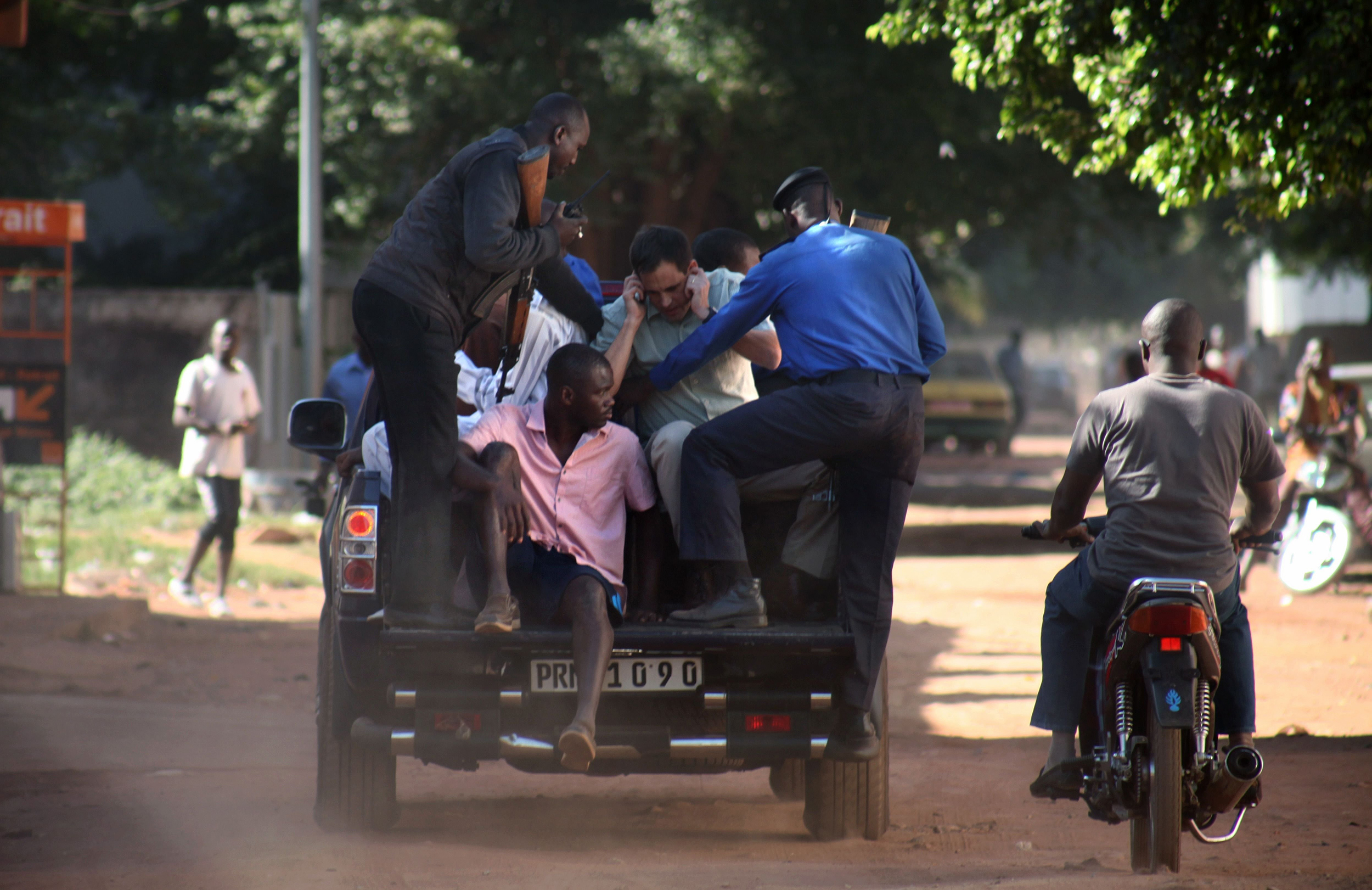 Malian security forces evacuate hostages freed from the Radisson Blu hotel in Bamako, Mali on Nov. 20, 2015.