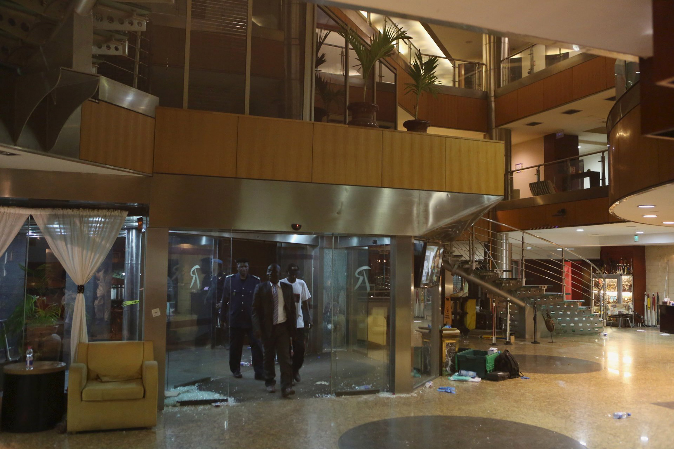 Malian officials enter the lobby of the Radisson hotel in Bamako, Mali, on Nov. 20, 2015.