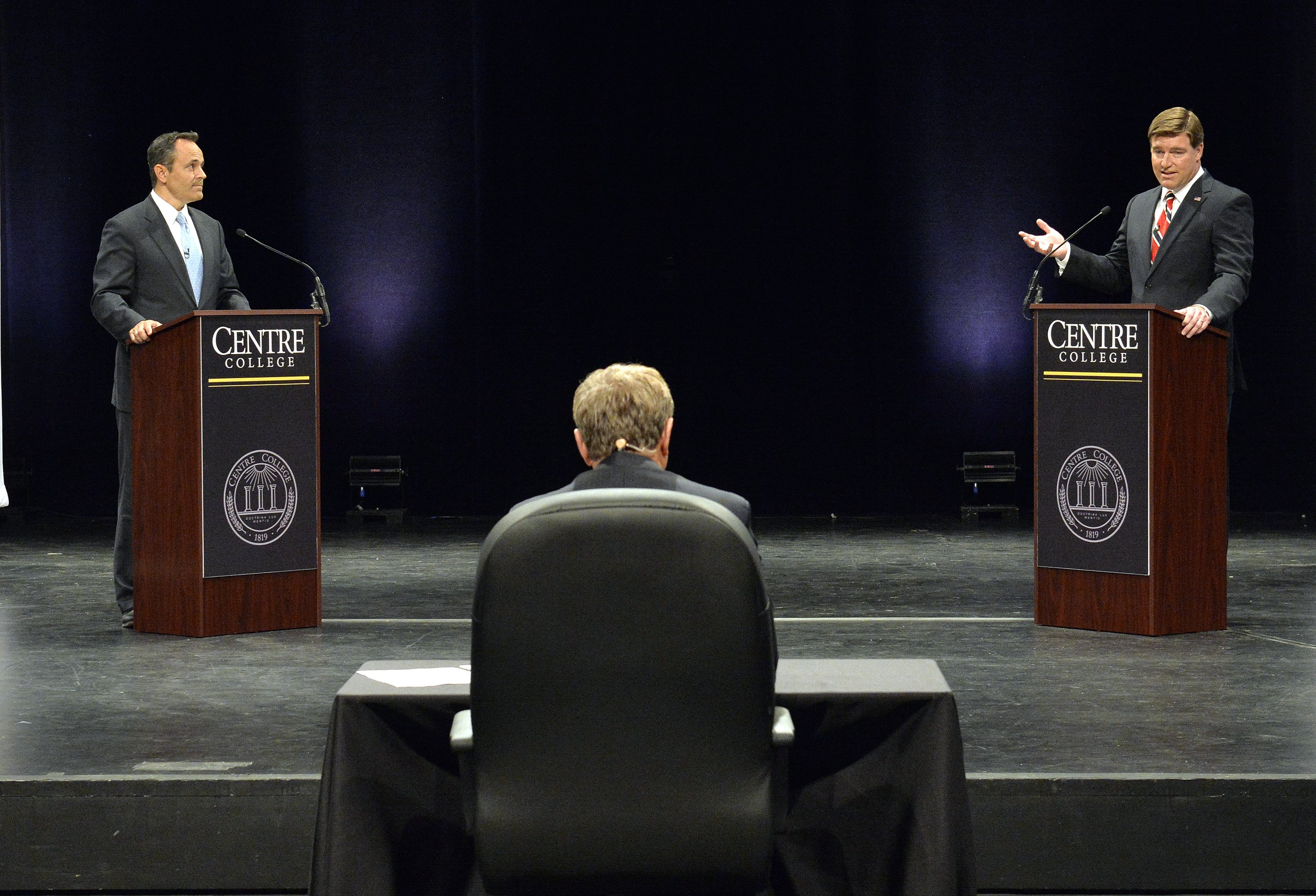 Kentucky Democratic gubernatorial candidate Jack Conway, right, responds to a question from the moderator, as his opponent, Republican Matt Bevin Looks on during the 2015 Kentucky Gubernatorial Debate hosted by Centre College on Oct. 6, 2015, in Danville, Ky.