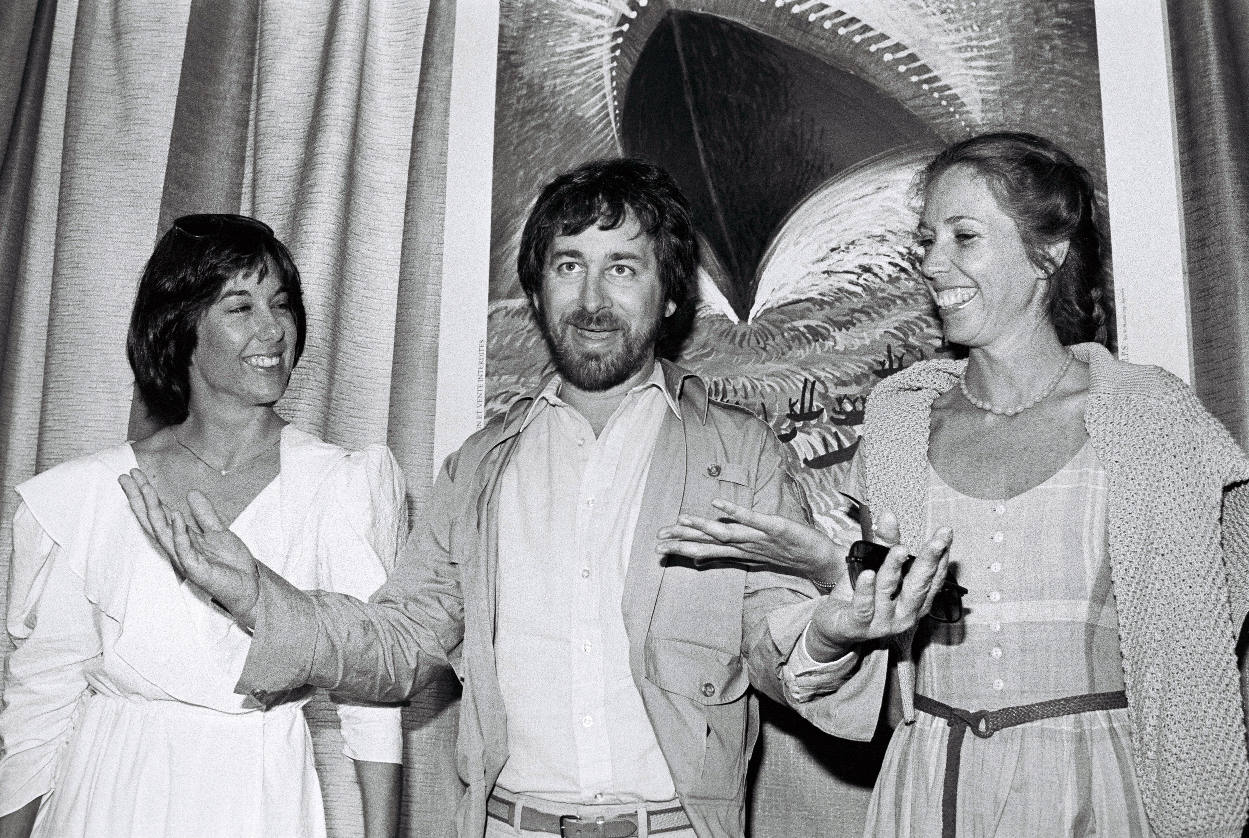 Director Steven Spielberg (C) poses with producer Kathleen Kennedy (L) and screenwriter Melissa Mathison (R) at the 35th Cannes Film Festival, during a photocall for his film 'E.T. the Extra-Terrestrial' in 1982.