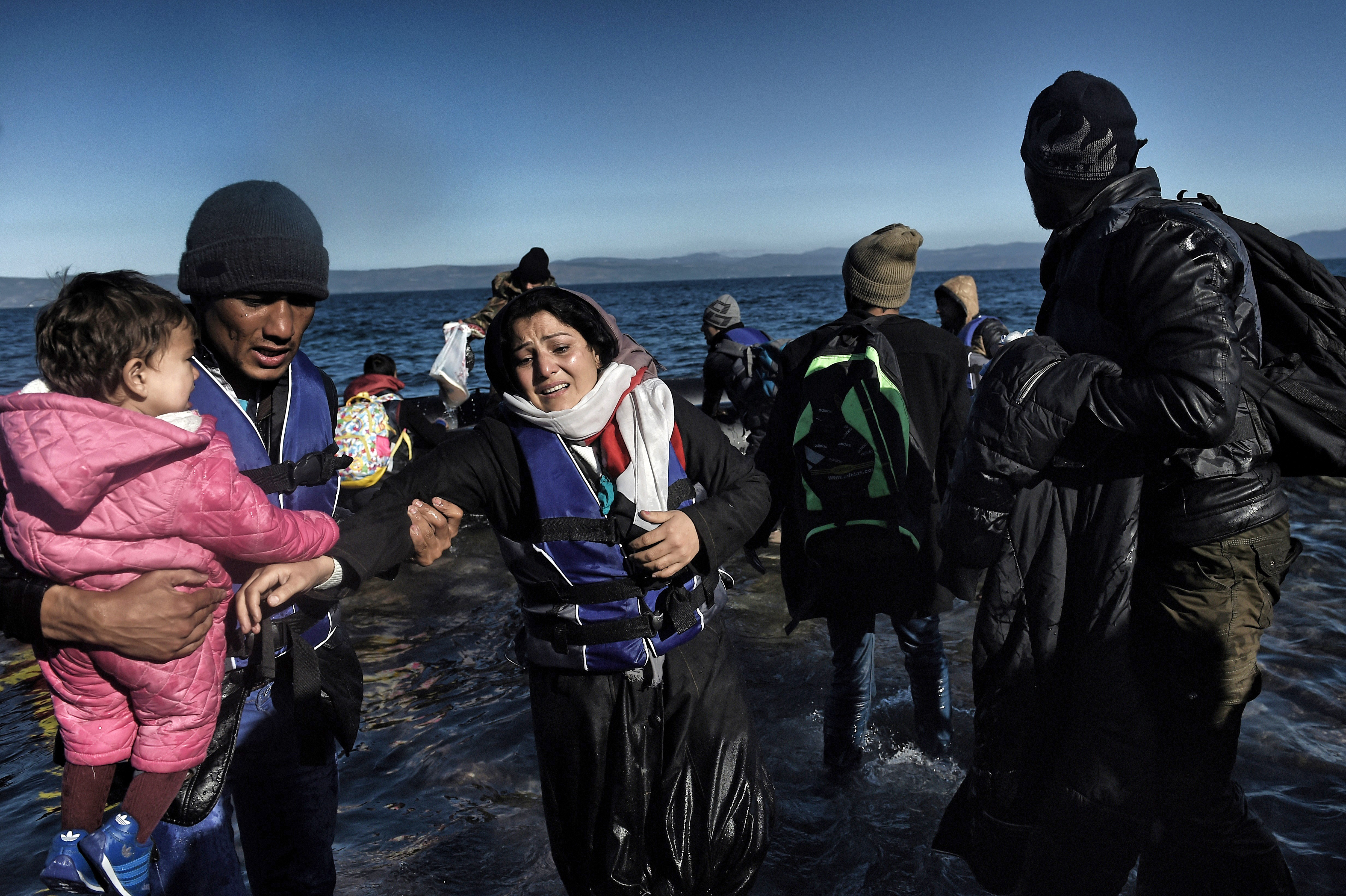 Refugees and migrants arrive on the Greek island of Lesbos after crossing the Aegean Sea from Turkey on November 2, 2015.