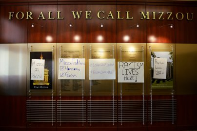 "Posters from a ""#RacismLivesHere"" rally are displayed at Jesse Hall at the University of Missouri campus following a student march on Sept. 24, 2015 in Columbia, Mo. Students said that racism is a problem on their campus."