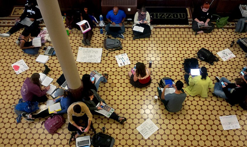People sit on the floor of Jesse Hall during a Black Lives Matter study hall on Oct. 6, 2015 in Columbia, Mo. The study hall was held after a racial slur interrupted a Legion of Black Collegians Royalty Court rehearsal.