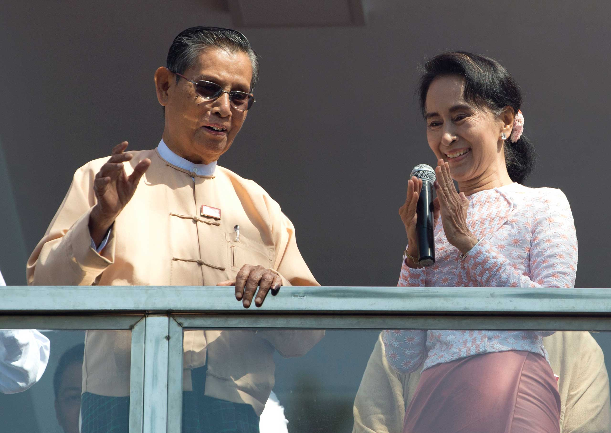 Aung San Suu Kyi delivers a speech with party patron Tin Oo from a balcony of her party's headquarters in Rangoon, Burma, on Nov. 9, 2015.