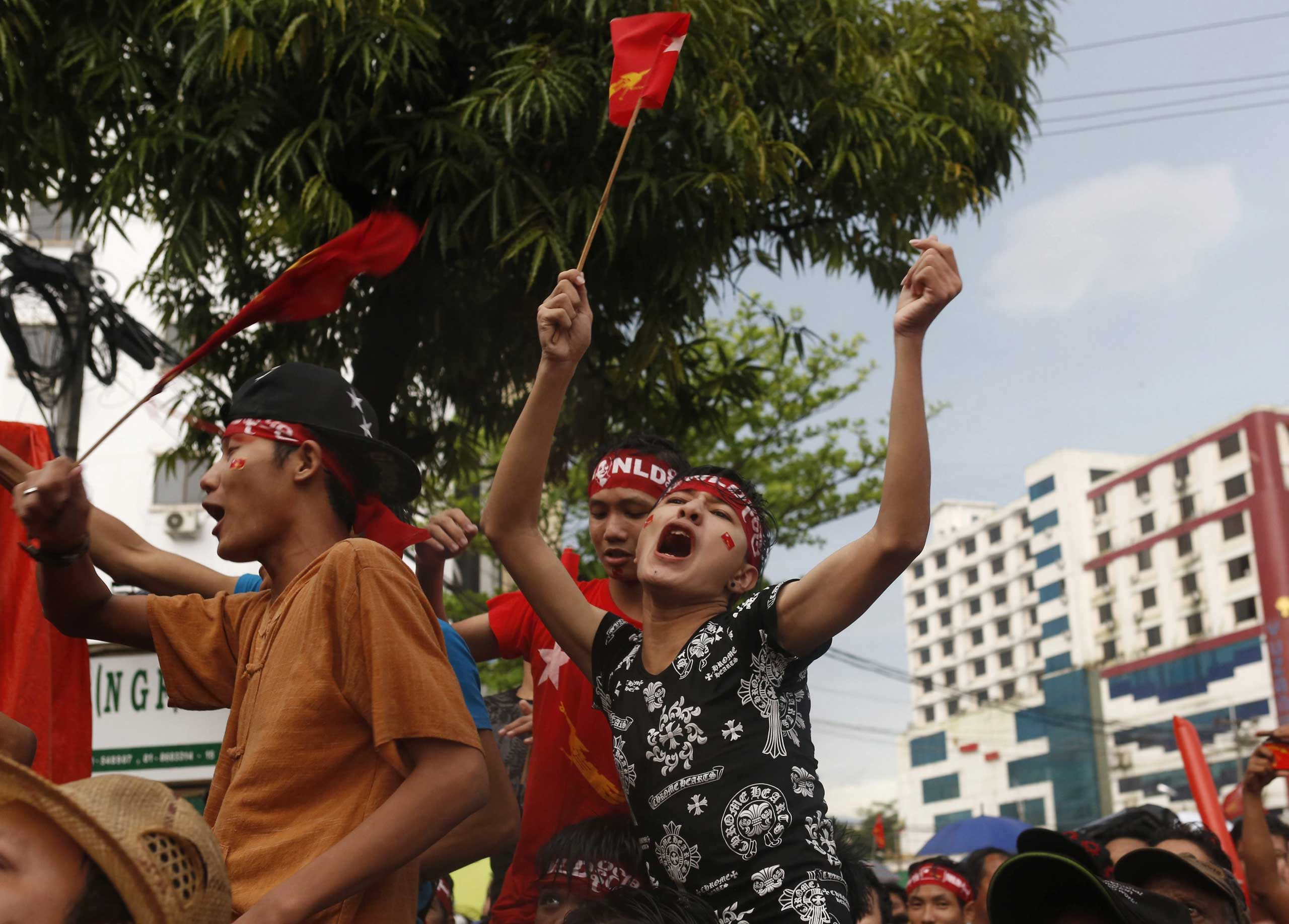 Supporters of National League for Democracy (NLD) party celebrate in front of NLD headquarters a day after the general elections in Rangoon, Burma, on Nov. 9,  2015.