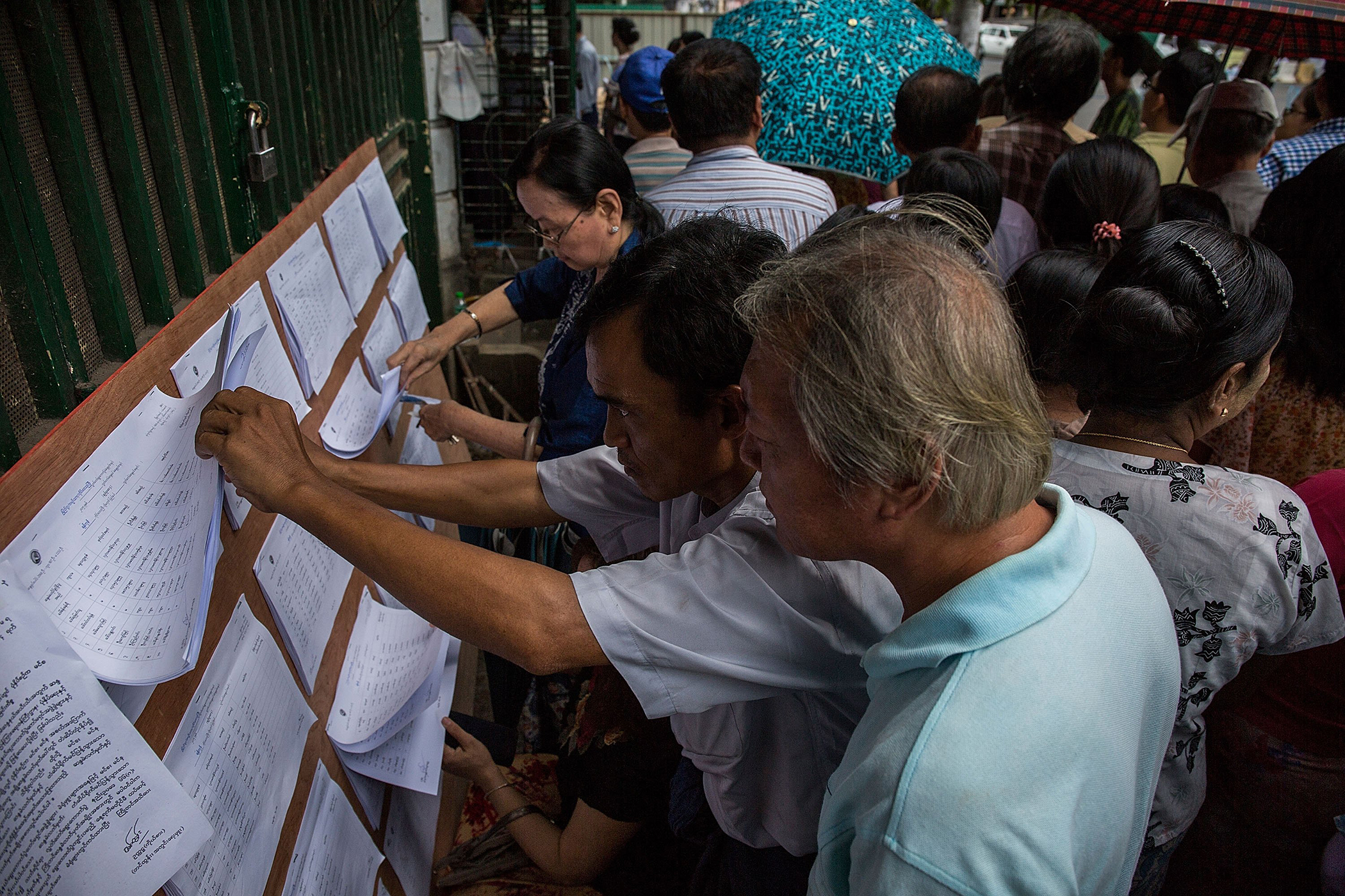 Voters check the list at a polling station in the Chinatown during Myanmar's first free and fair election in Yangon on Nov. 8, 2015.