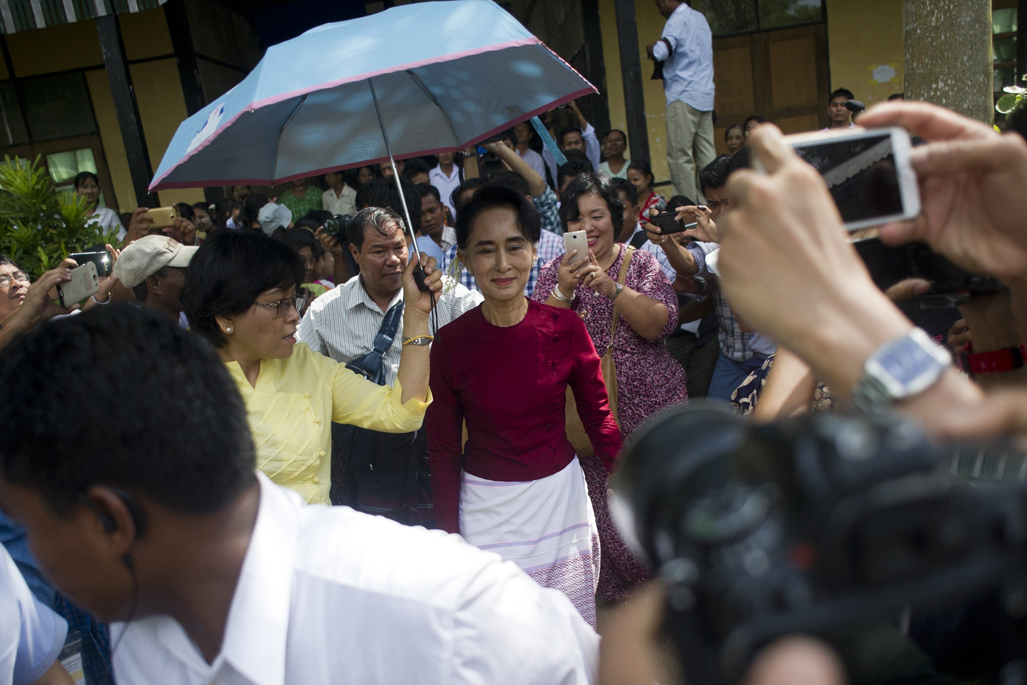 Aung San Suu Kyivisits a polling station in Kawhmu township, Yangon on Nov. 8, 2015.