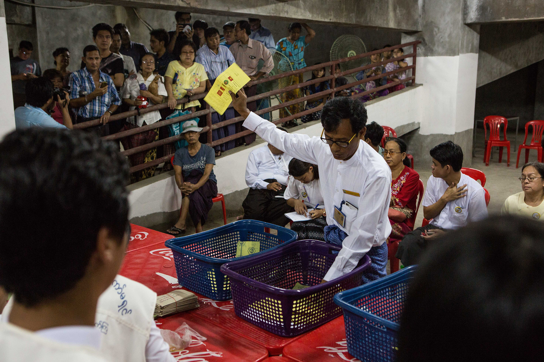 Votes are counted in an unfinished building being used as a polling station in Yangon on Nov. 8, 2015.