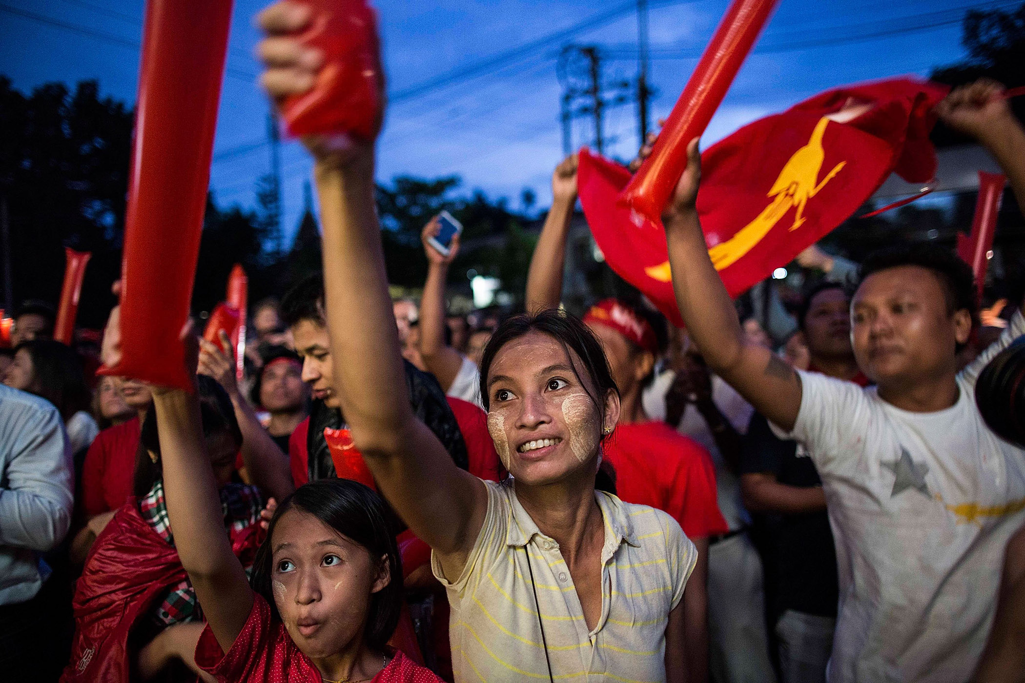 People take part of the rally outside the National League for Democracy office after Burma's first free and fair election, in Yangon on Nov. 8, 2015.
