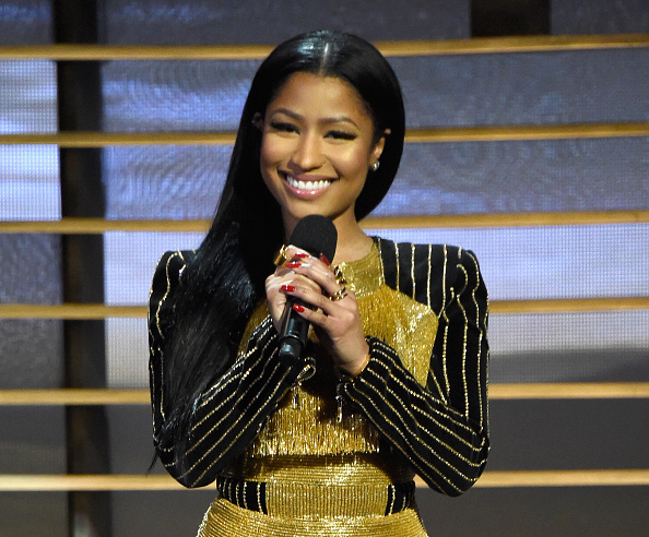 Recording artist Nicki Minaj speaks onstage at A+E Networks 'Shining A Light' concert at The Shrine Auditorium on November 18, 2015 in Los Angeles, California.