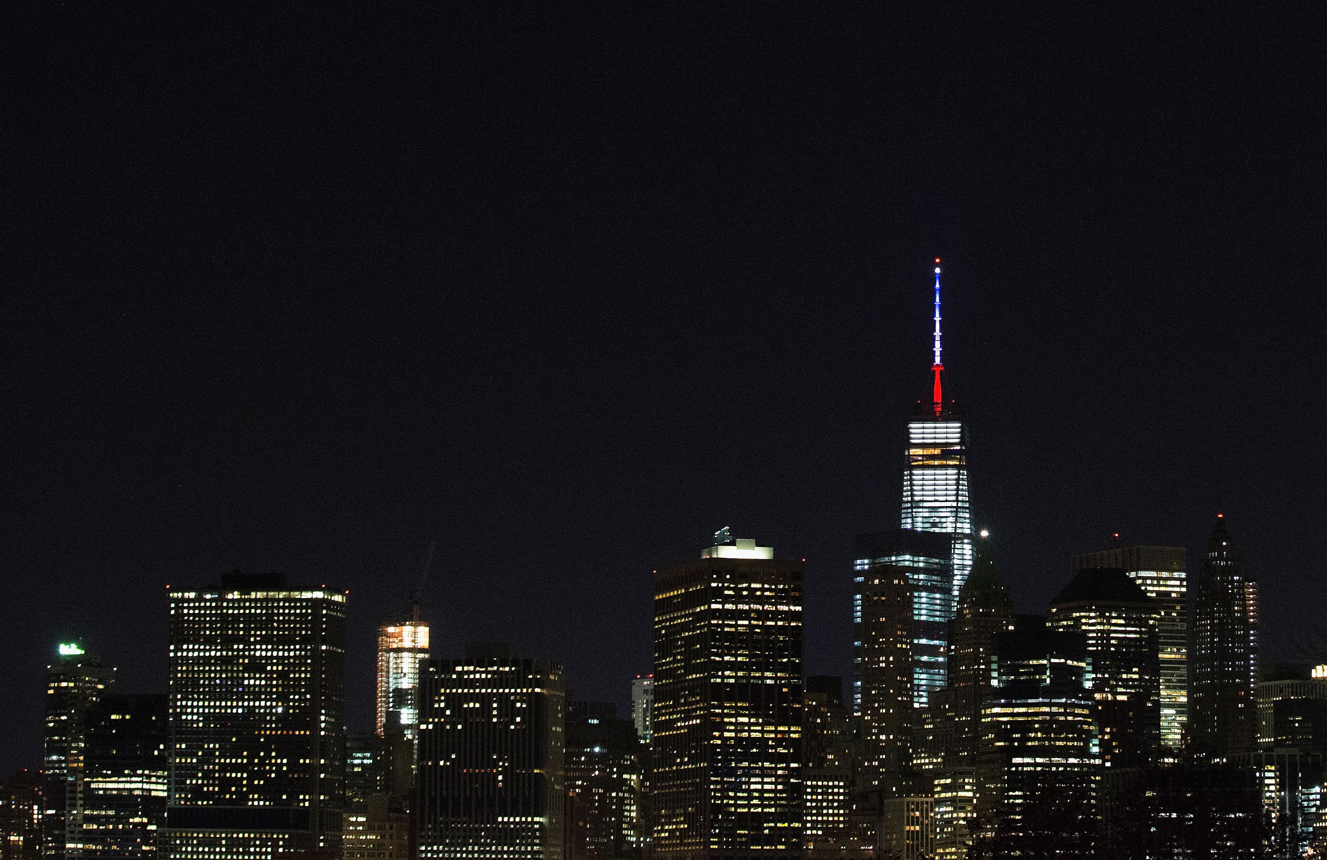 One World Trade Center's spire is lit in the colors of the French flag, white, blue and red, in solidarity with France after terror attacks in Paris on Nov. 13, 2015 in New York City.