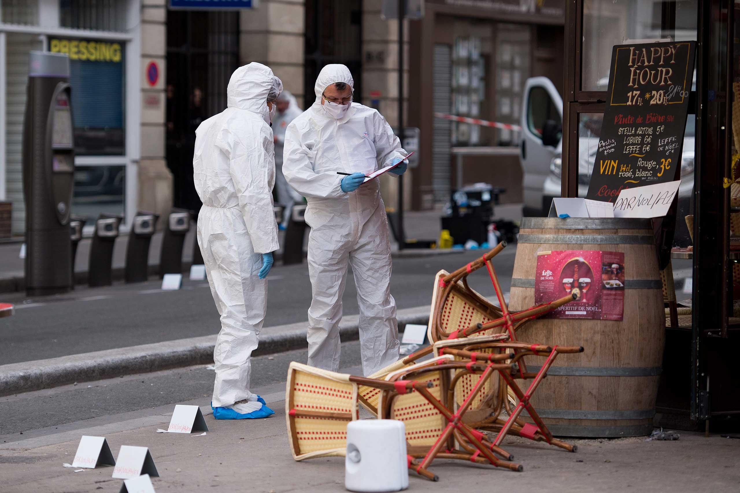Police forensic experts work on the scene at the Cafe Comptoir Voltaire in Paris, Nov, 14,  2015.
