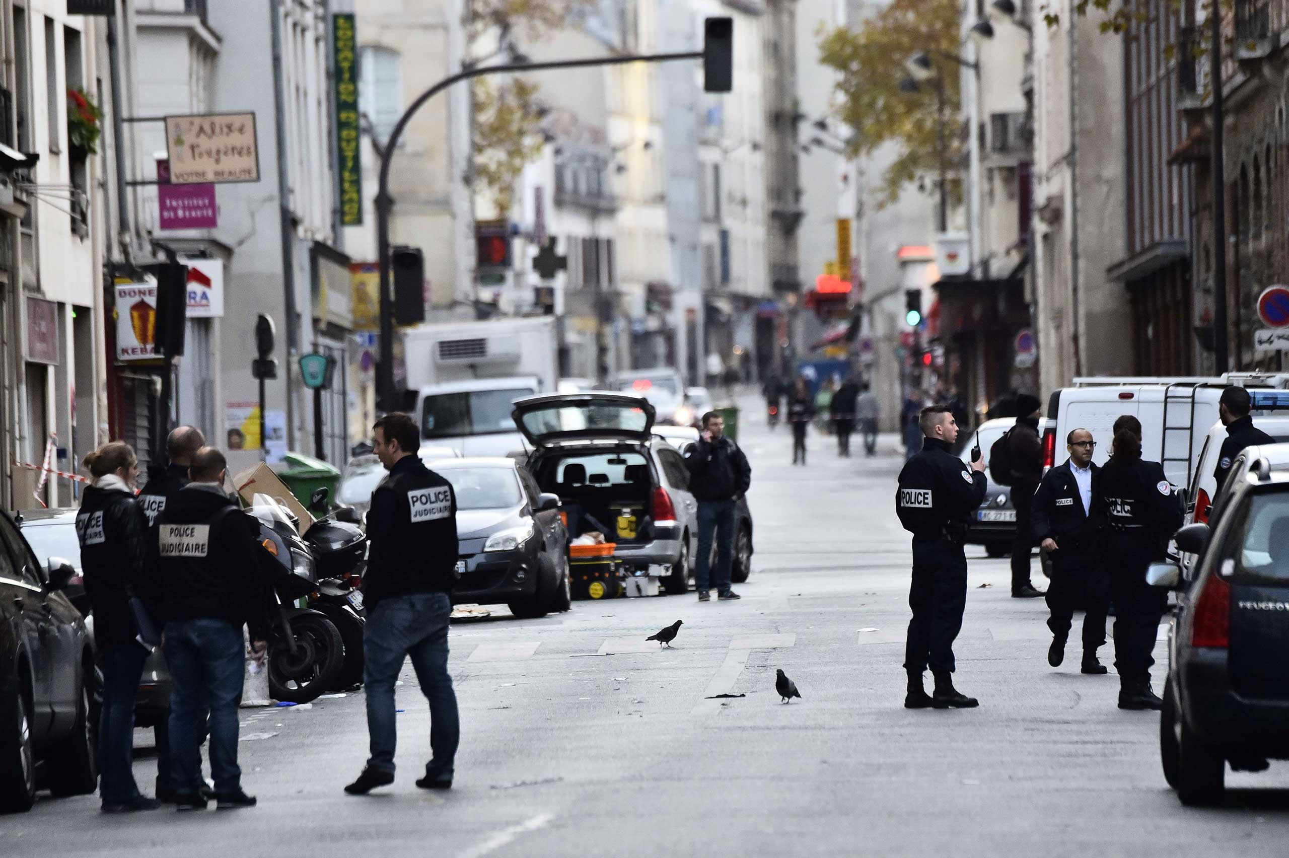 Police are seen near the Cafe La Belle Equipe at the Rue de Charonne in Paris, on Nov. 14, 2015.