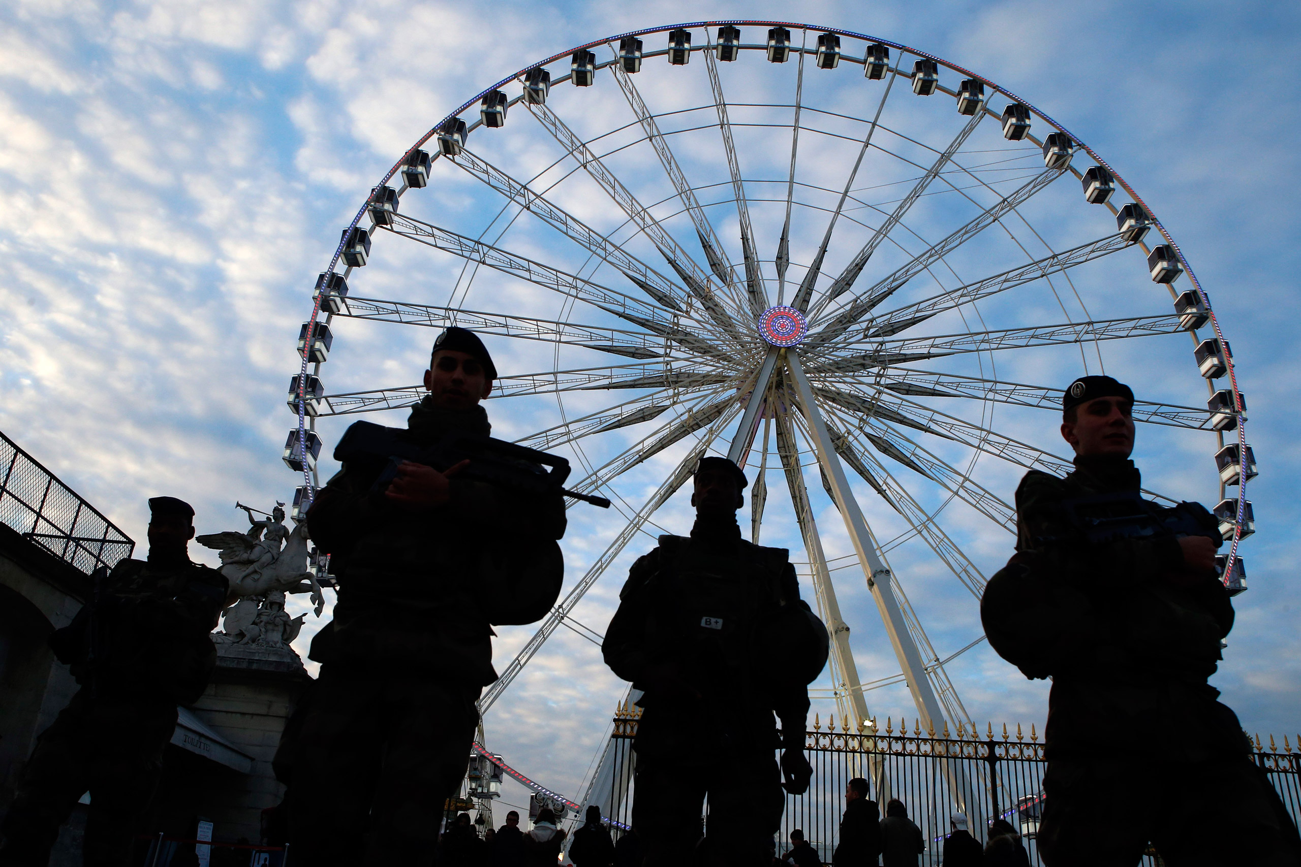 French soldiers patrol in front of the Paris ferris Big Wheel next to the Champs Elysees in Paris on Nov. 22, 2015.
