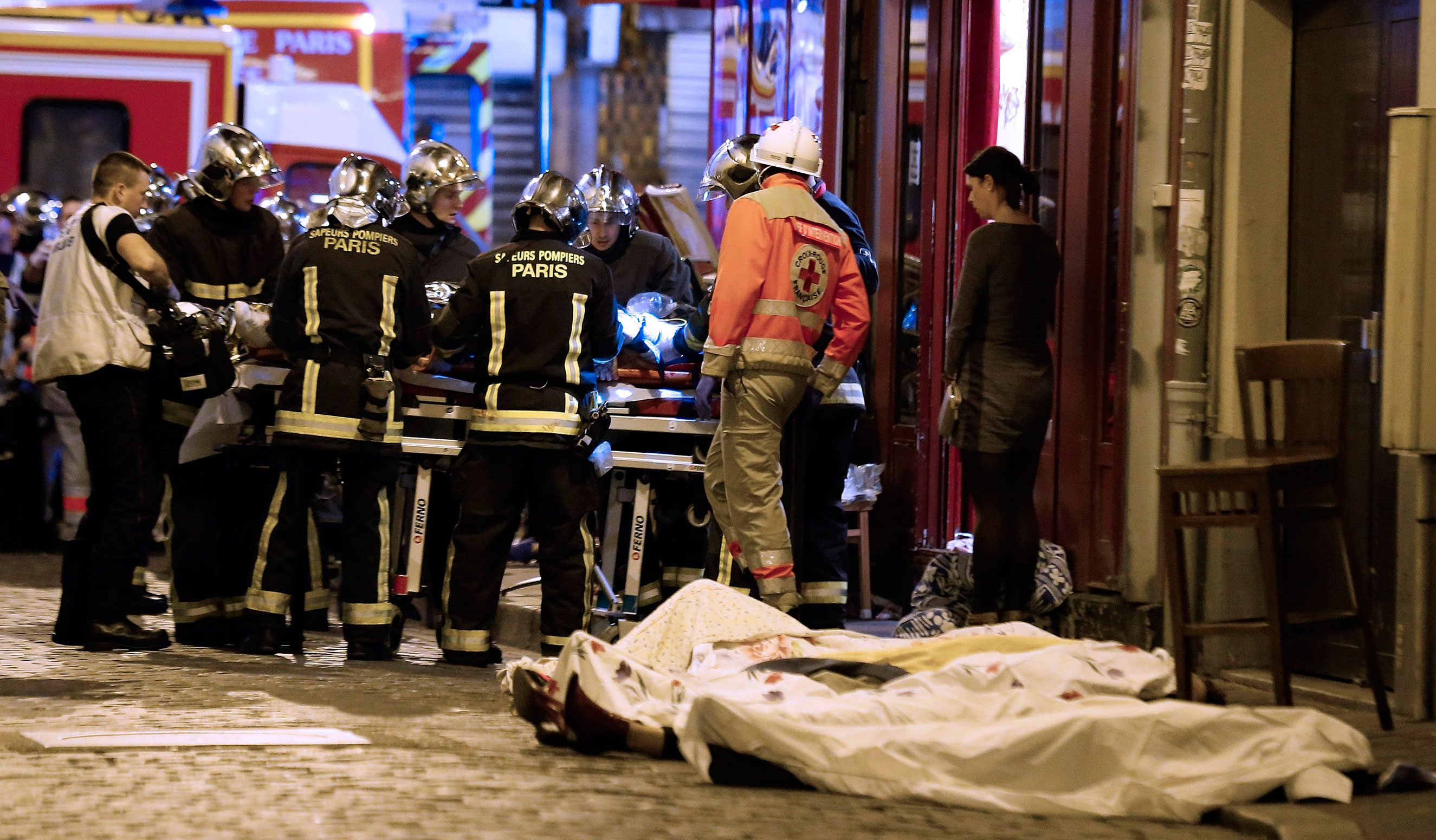 Rescue workers attend to victims of the attacks in the 10th district of Paris on Nov. 13, 2015.