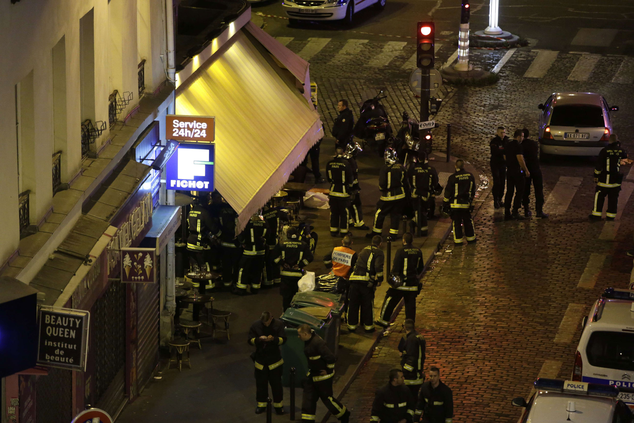 Police are seen outside a restaurant in 10th arrondissement of the French capital Paris on Nov. 13, 2015.