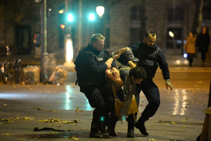 A suspect is apprehended  near Place Republique on Nov. 13, 2015, in Paris.
