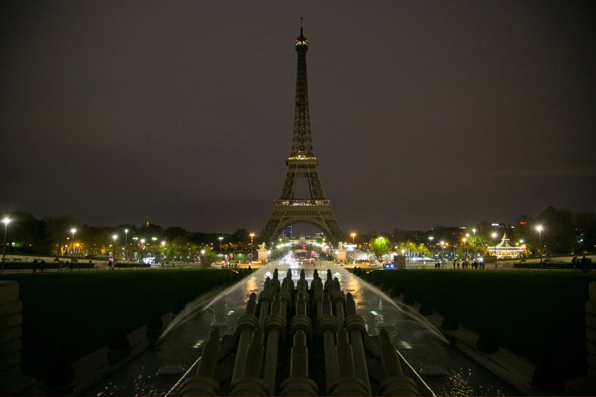 The Eiffel Tower turns off its lights in memory of the more than 120 victims the day after the terrorist attack on Nov. 14, 2015 in Paris.