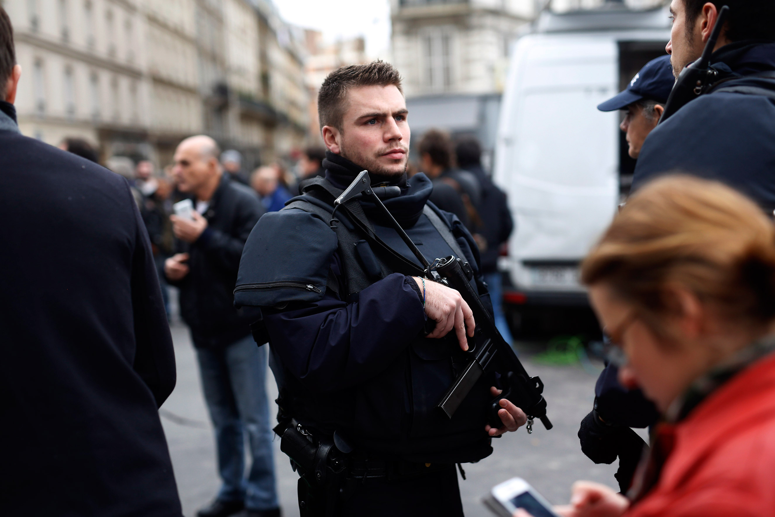 A police officer patrols outside the Carillon cafe and the Petit Cambodge restaurant in Paris on Nov. 14, 2015.