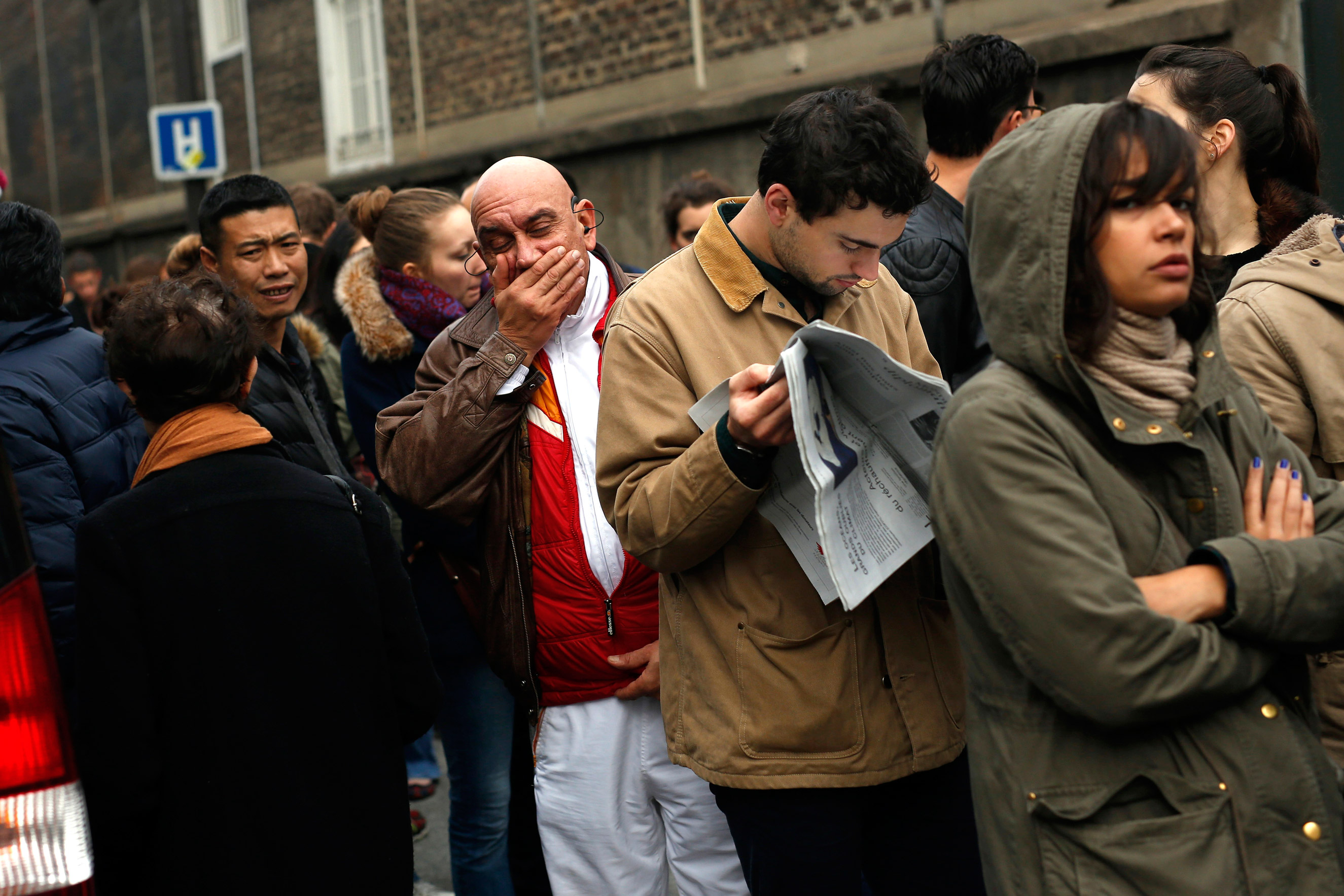 People line up to give blood at the St Louis hospital across the street from the Petit Cambodge restaurant in Paris on Nov. 14, 2015.
