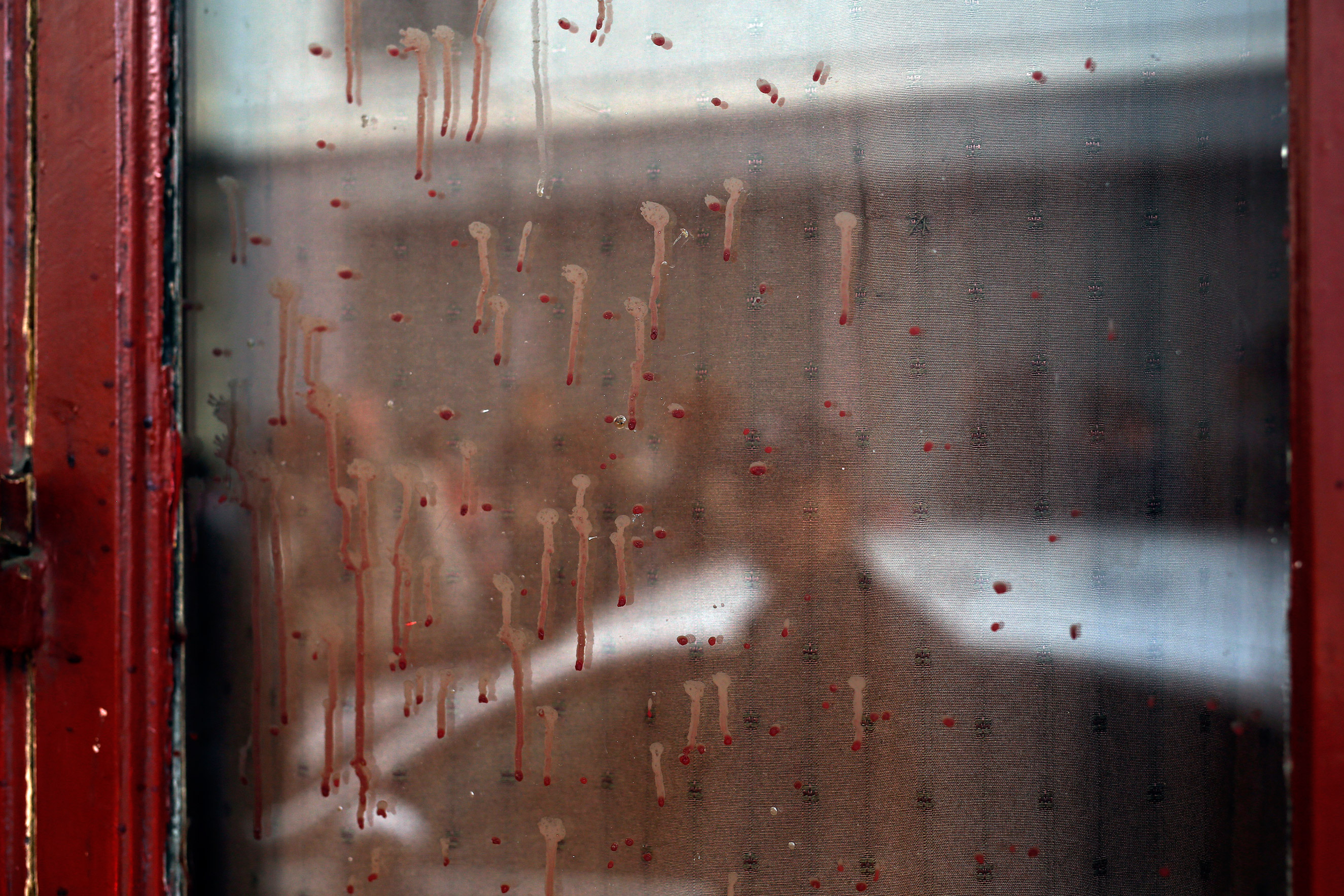Dried blood on the window of the Carillon cafe in Paris on Nov. 14, 2015.