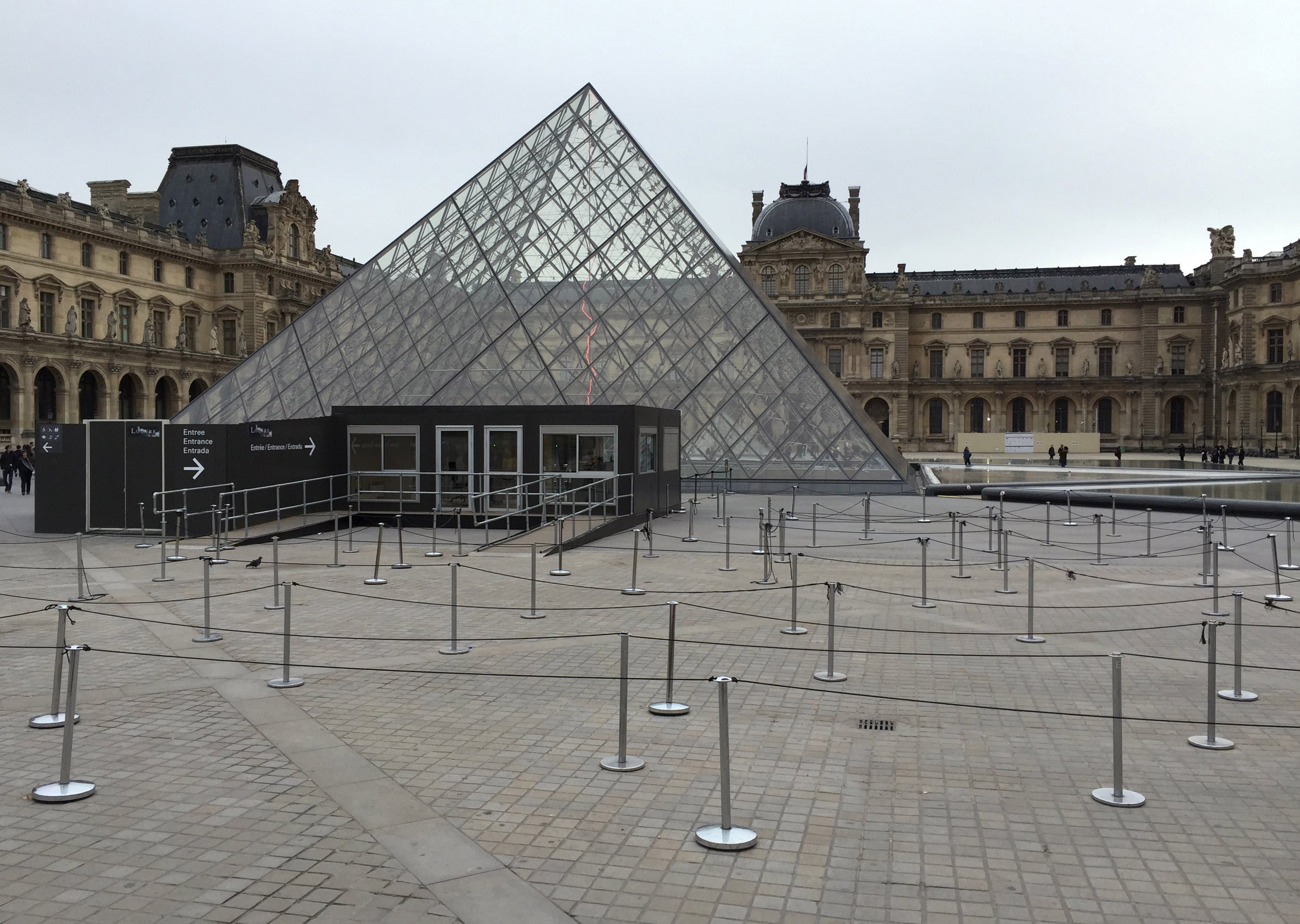 The entrance of the Louvre is seen deserted after the museum was closed following a series of deadly attacks in Paris, on Nov. 14, 2015.
