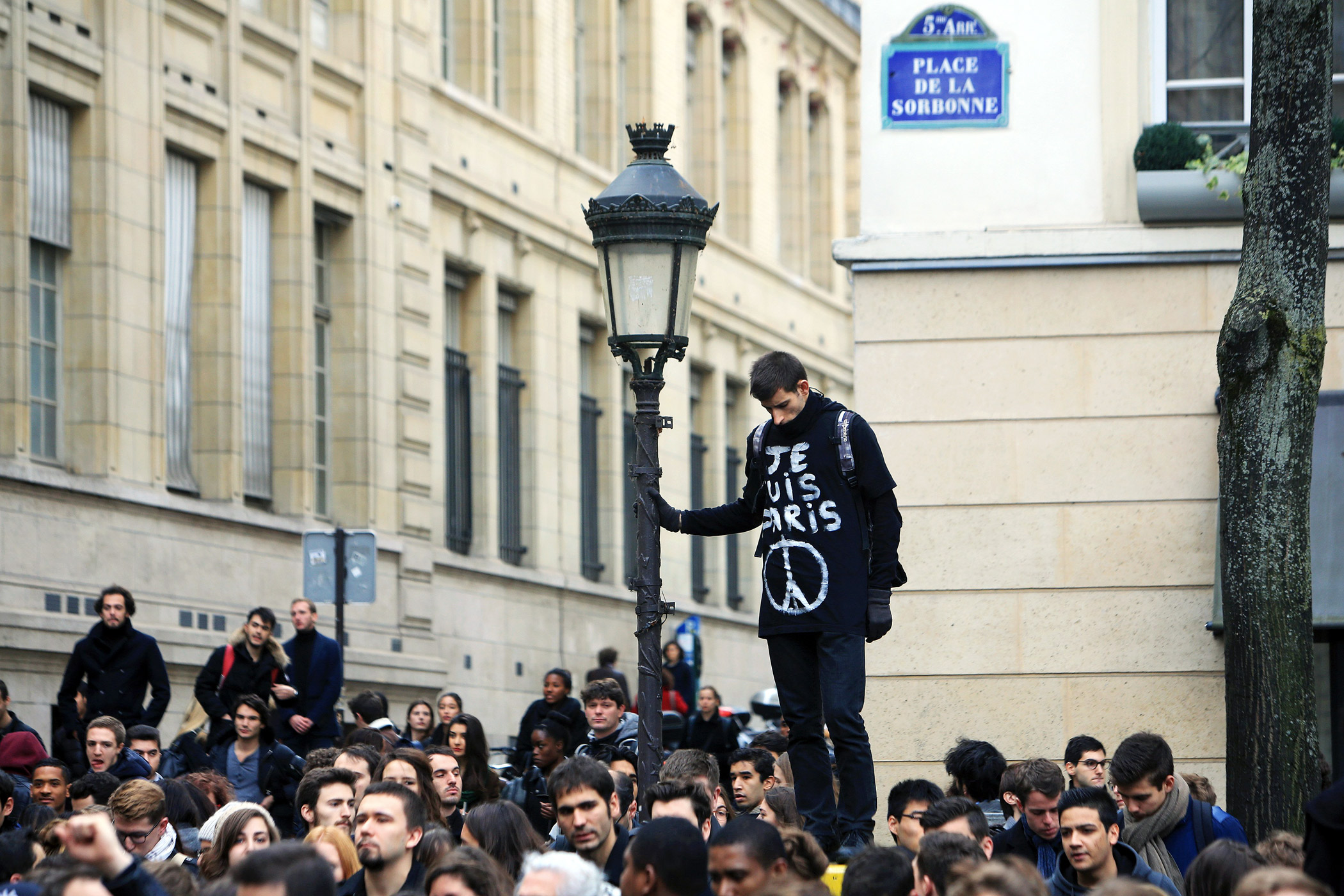 A man wears a shirt that says  I am Paris  during a minute of silence, outside the Sorbonne University.