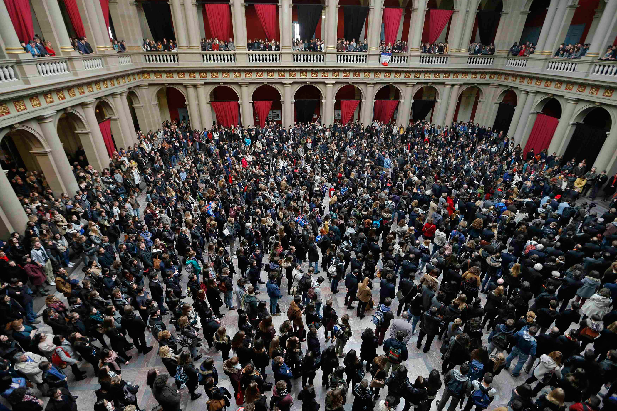 Students and teachers of Strasbourg University observe a minute of silence at the  Palais Universitaire  in Strasbourg, to pay tribute to victims of Friday's attacks on Paris.