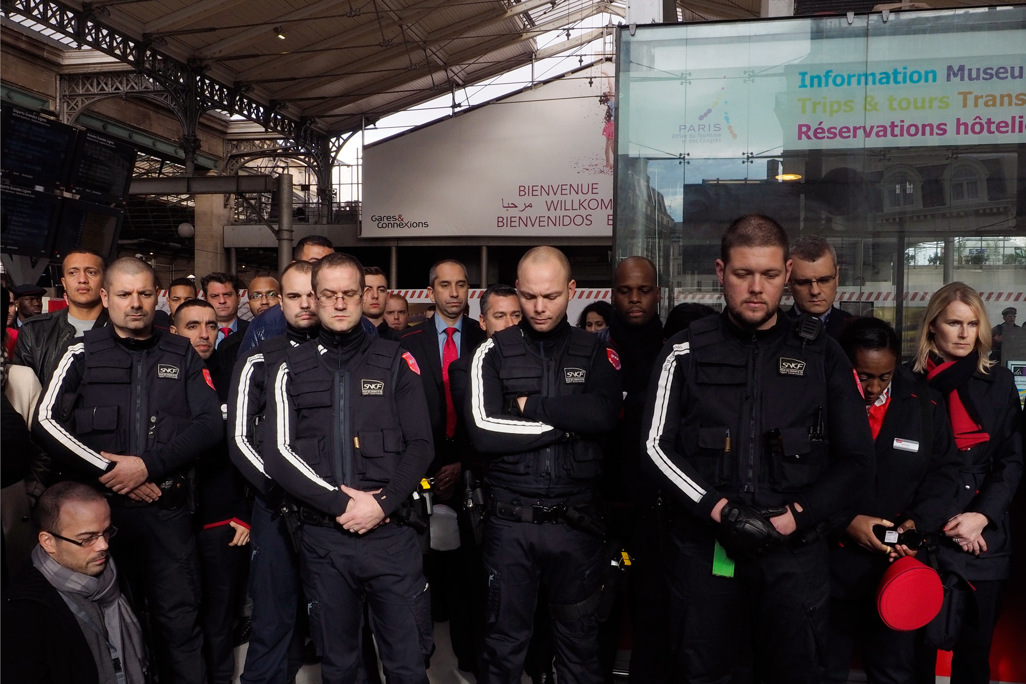 SNCF staff observe a minute of silence for the victims of go the attacks on Paris at Gare du Nord.