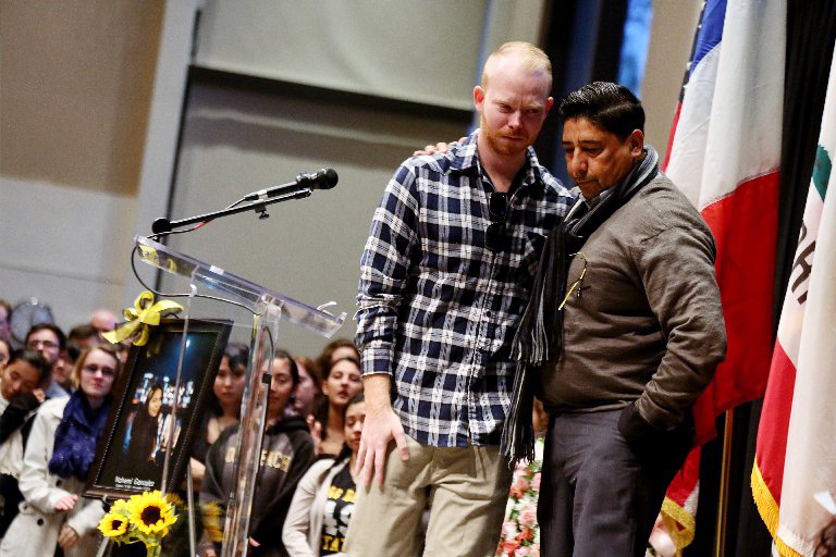 Tim Mraz, boyfriend of Nohemi Gonzalez, is joined by her stepfather Jesse Hernandez during a vigil for Gonzalez, who was killed during the attacks in Paris.