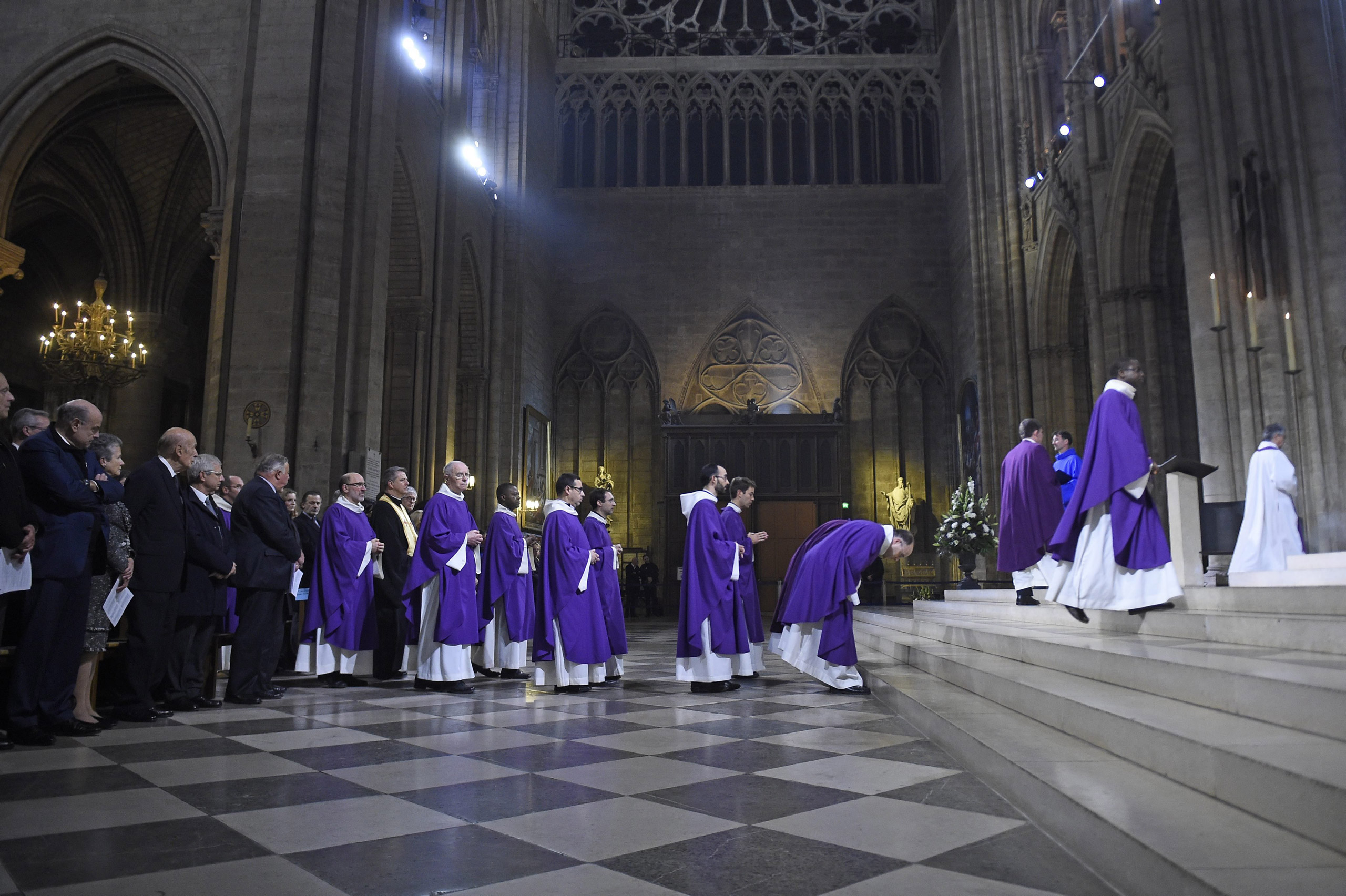 Prelates arrive to celebrate a mass in homage to the victims of the Paris attacks at the Notre Dame cathedral in Paris on Nov. 15, 2015.