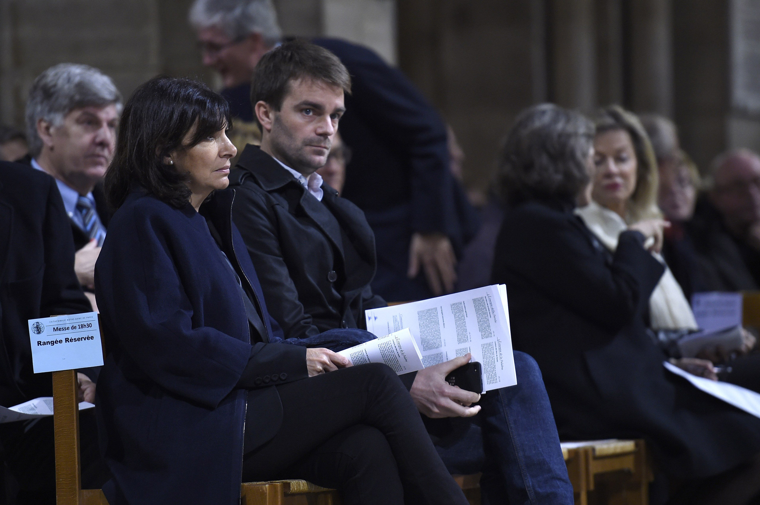 Paris mayor Anne Hidalgo and Deputy-Mayor Bruno Julliard attend a ceremony in memory of the victims of the terrorist attacks at Notre Dame cathedral in Paris on Nov. 15, 2015.