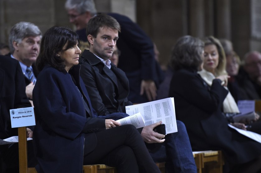 Paris mayor Anne Hidalgo (L) and Deputy-Mayor Bruno Julliard attend a mass service in homage to the attacks' victims at the Notre-Dame cathedral in Paris on November 15, 2015, two days after a series of deadly attacks. Islamic State jihadists claimed a series of coordinated attacks by gunmen and suicide bombers in Paris on November 13 that killed at least 129 people in scenes of carnage at a concert hall, restaurants and the national stadium. AFP PHOTO / LIONEL BONAVENTURELIONEL BONAVENTURE/AFP/Getty Images