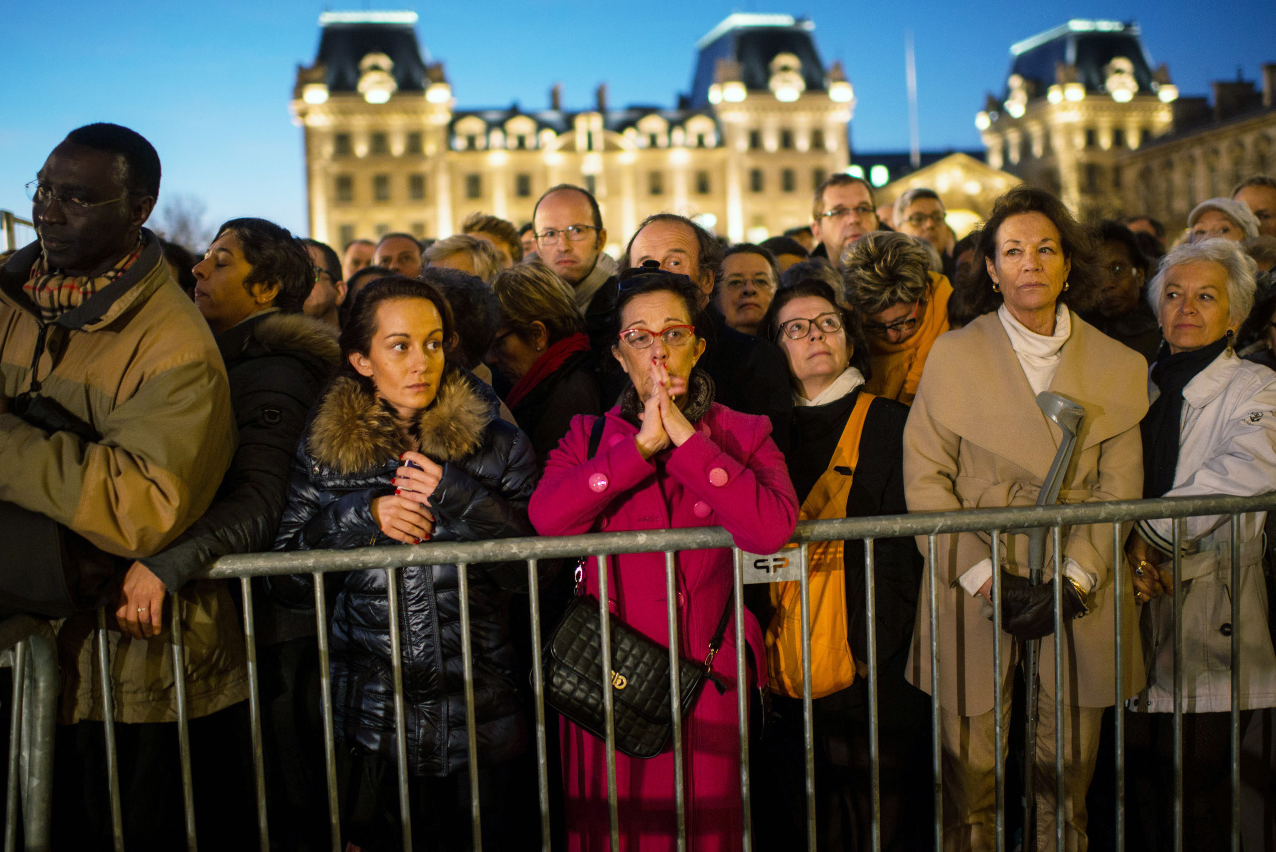People gather outside of Notre Dame cathedral ahead of a ceremony in memory of the victims of the terrorist attacks in Paris on Nov. 15, 2015.